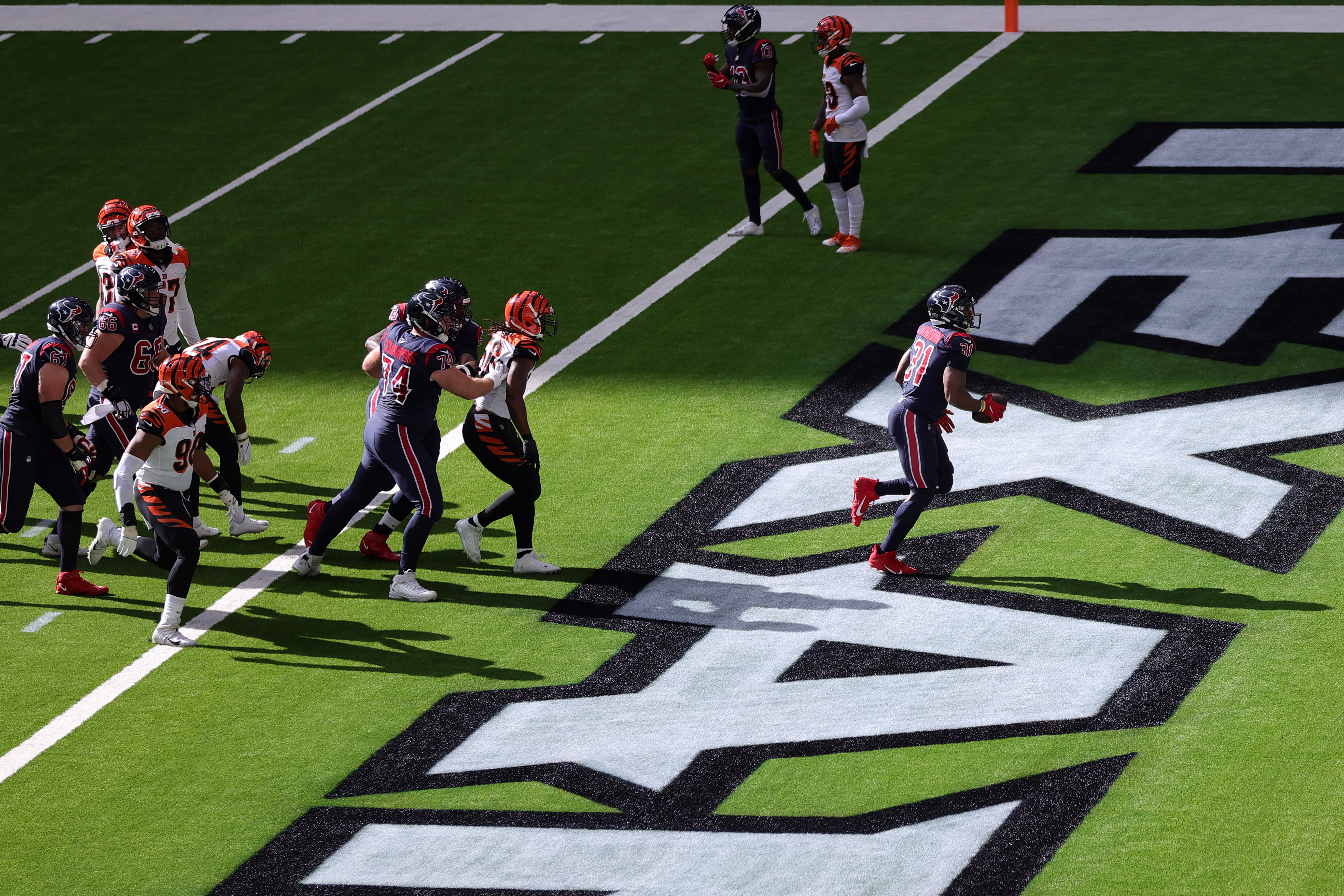 Running back David Johnson #31 of the Houston Texans rushes for a touchdown during the third quarter of the game of the game against the Cincinnati Bengals at NRG Stadium on December 27, 2020 in Houston, Texas.
