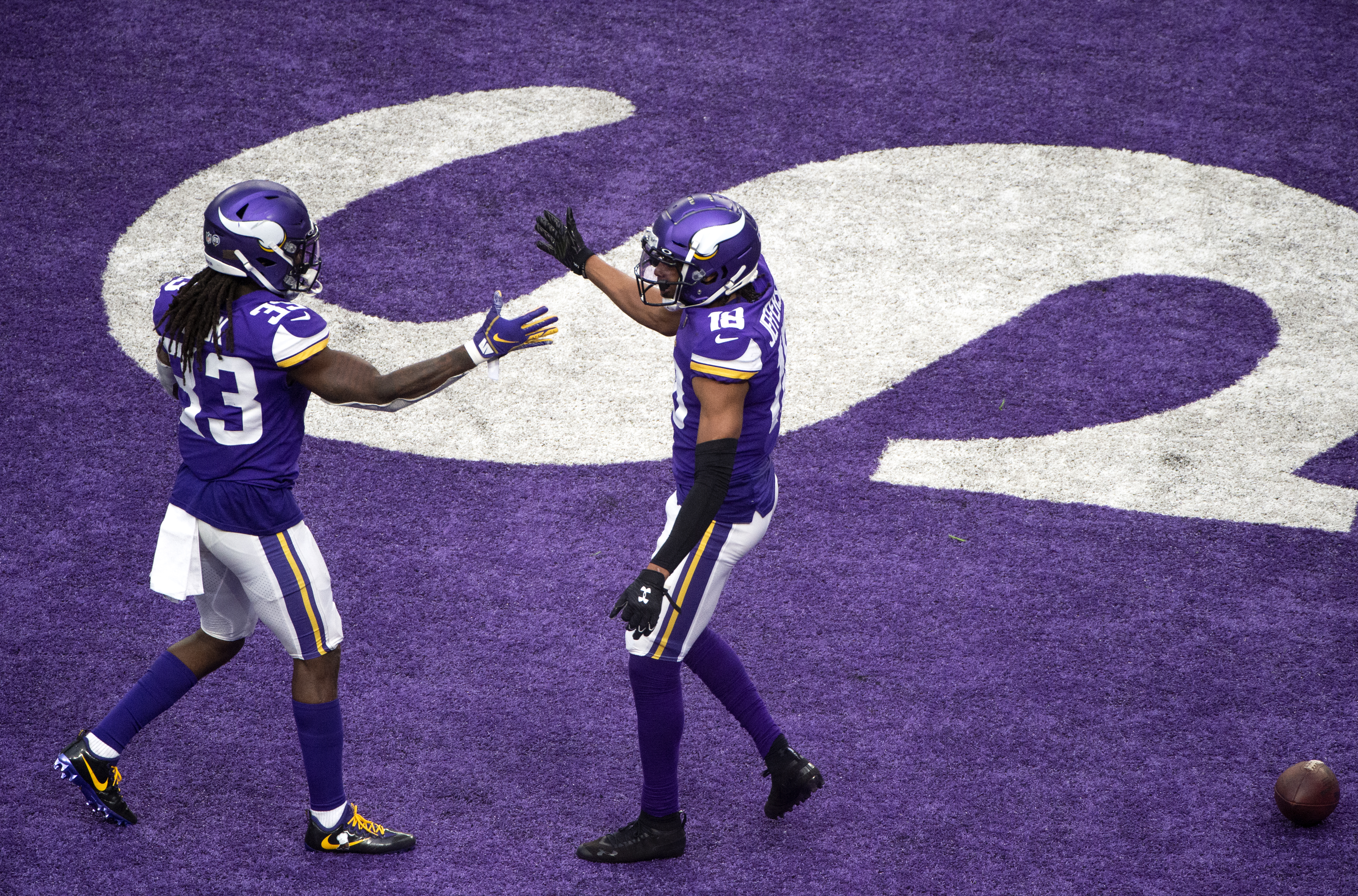 Justin Jefferson #18 celebrates with Dalvin Cook #33 of the Minnesota Vikings after scoring touchdown in the third quarter of the game against the Jacksonville Jaguars at U.S. Bank Stadium on December 6, 2020 in Minneapolis, Minnesota.