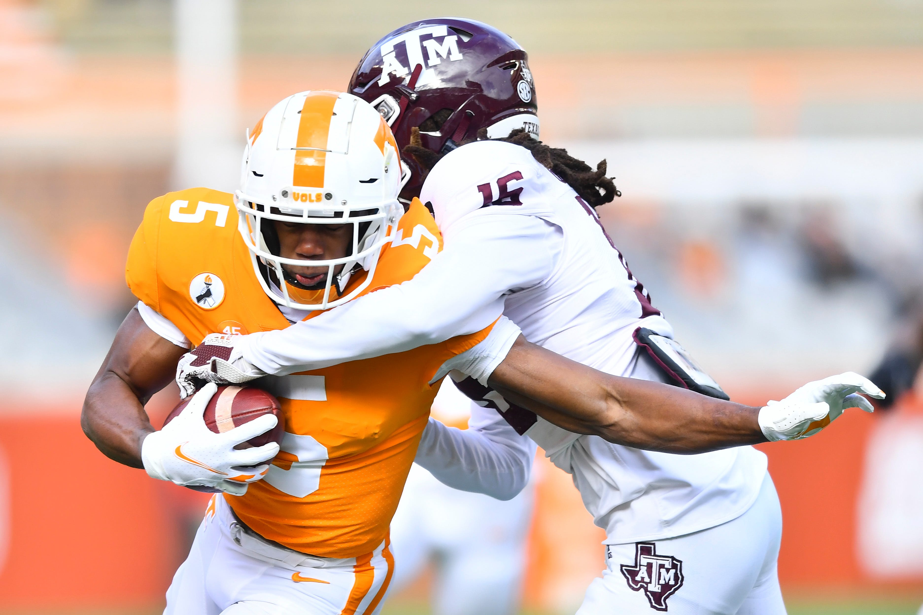 Tennessee wide receiver Josh Palmer (5) is tackled by Texas A&M defensive back Brian George (16) during a game between Tennessee and Texas A&M in Neyland Stadium in Knoxville, Saturday, Dec. 19, 2020.