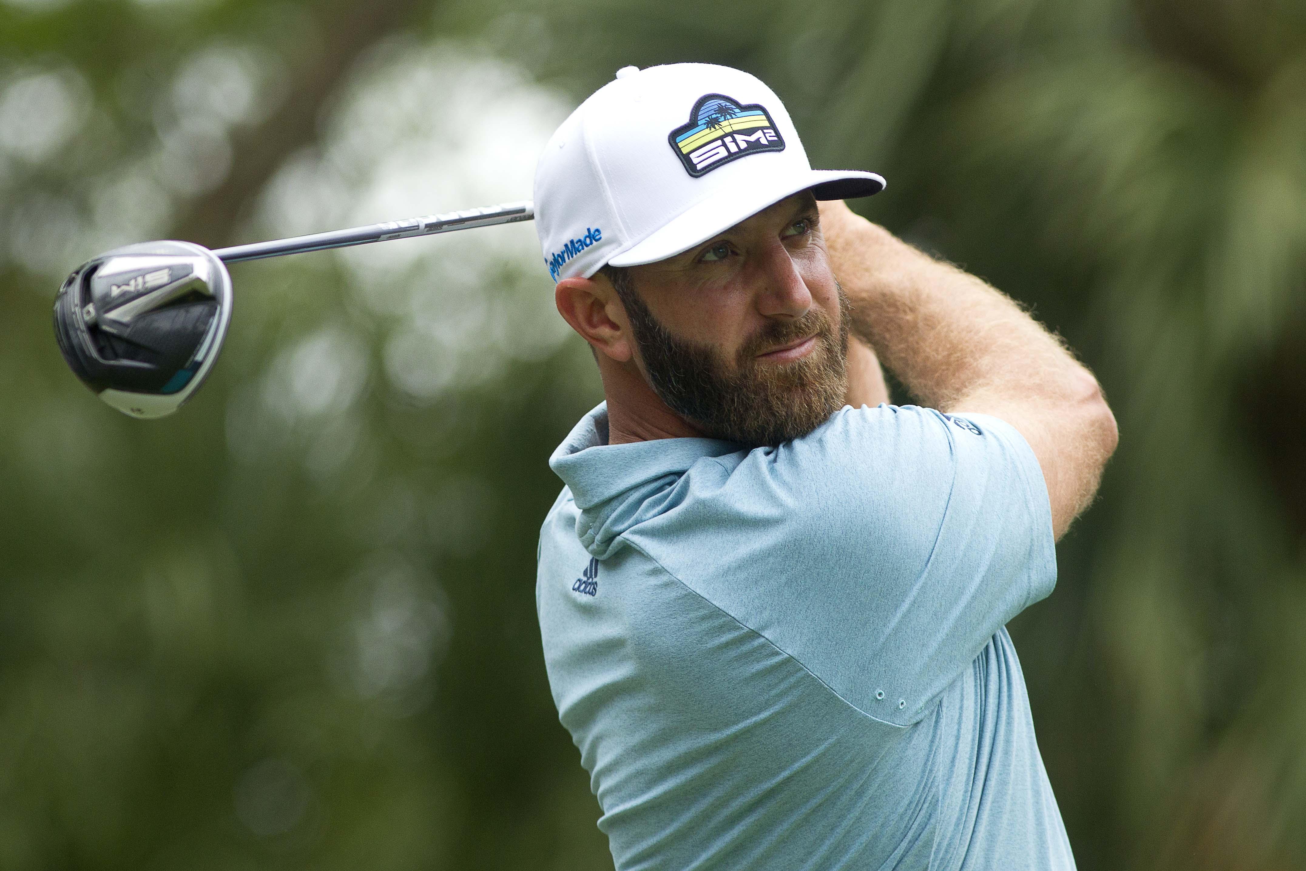 希尔顿黑德,南卡罗莱纳州,美国;在加拿大皇家银行传统高尔夫锦标赛的第一轮比赛中,达斯汀·约翰逊在第九洞开球。强制学分:约书亚·s·凯利