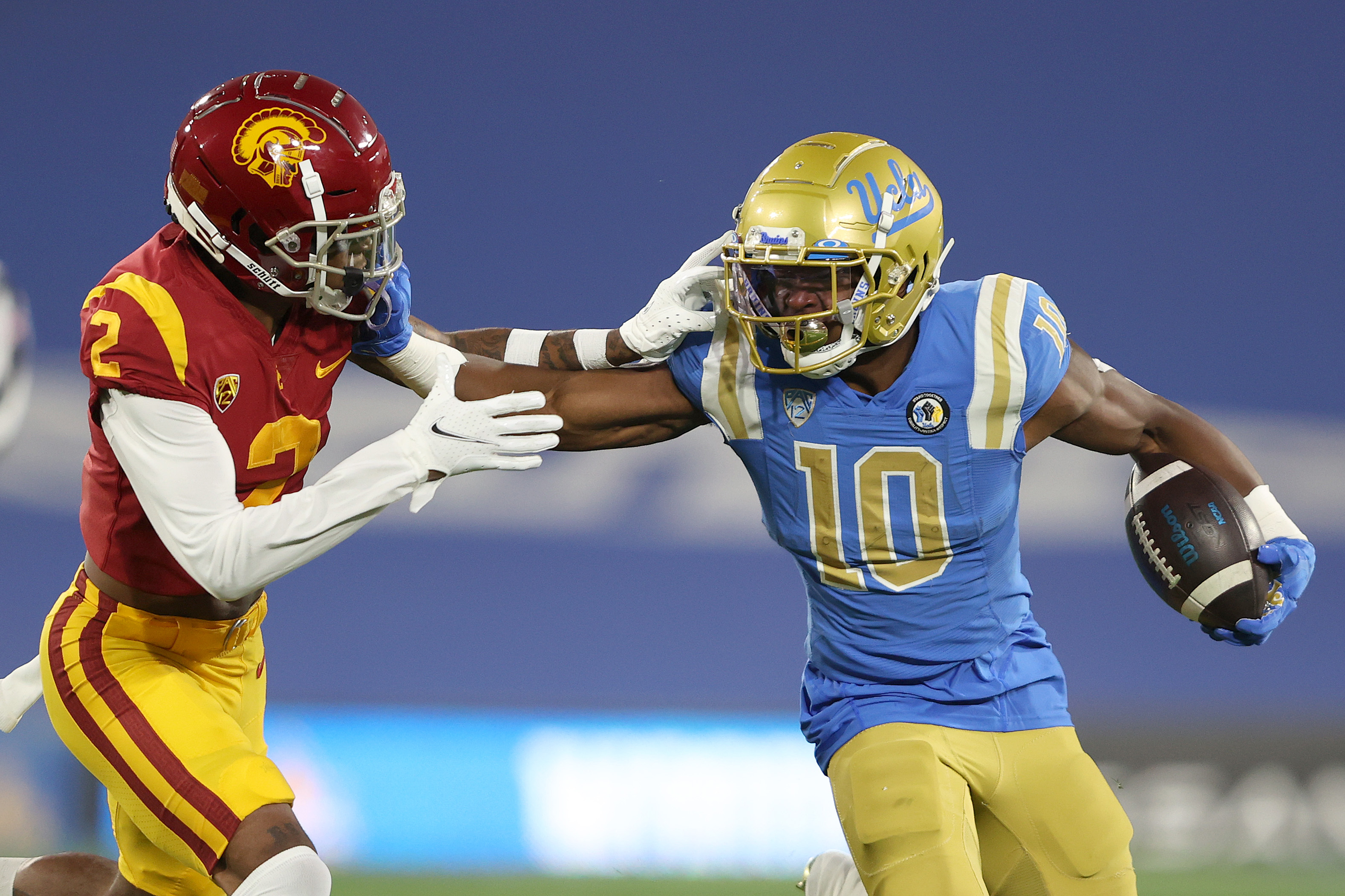Demetric Felton #10 of the UCLA Bruins eludes the tackle of Olaijah Griffin #2 of the USC Trojans during the first half of a game at the Rose Bowl on December 12, 2020 in Pasadena, California.