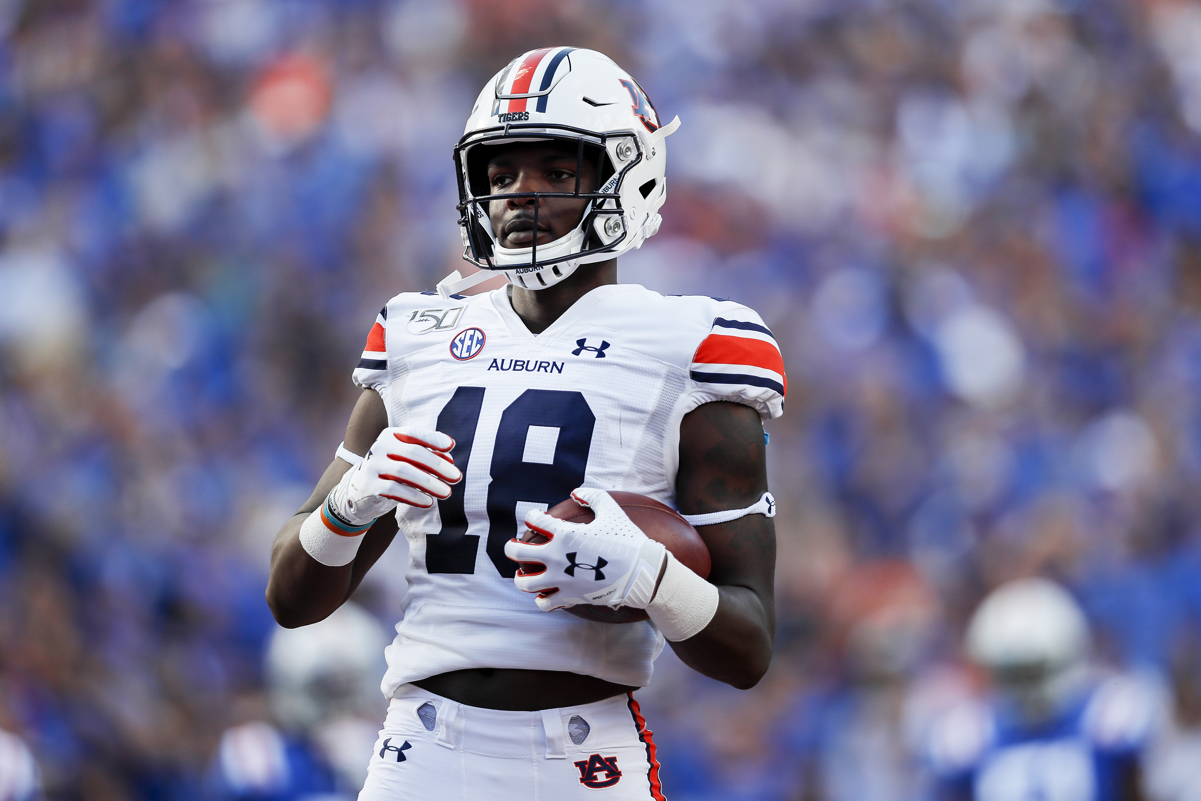 Seth Williams #18 of the Auburn Tigers scores a touchdown during the second quarter of a game against the Florida Gators at Ben Hill Griffin Stadium on October 05, 2019 in Gainesville, Florida.