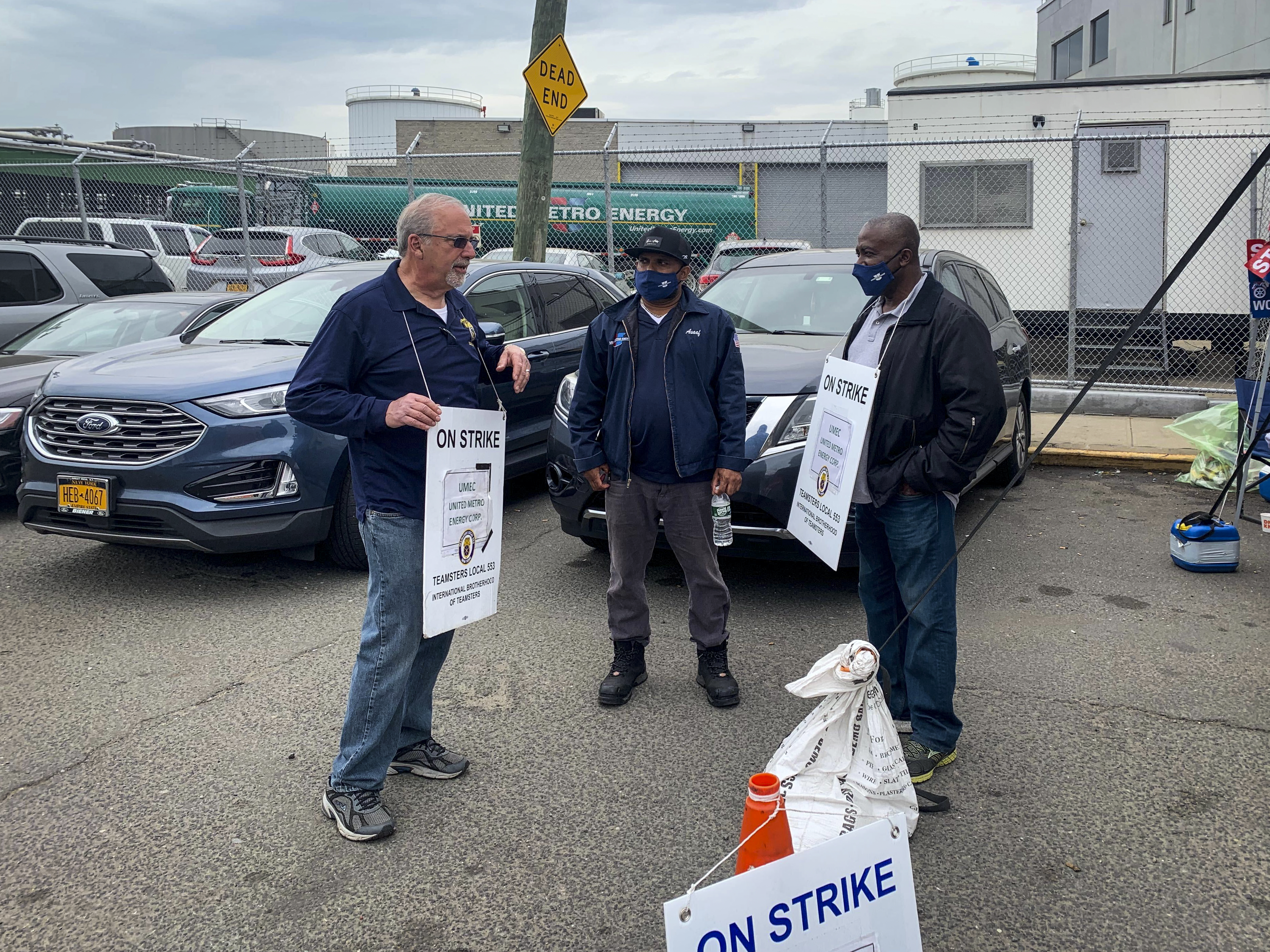 Left to right: Union rep Vic Castellano with Asaaf John and Andre Soleyn at Greenpoint's United Metro Energy worker strike, April 29, 2021.