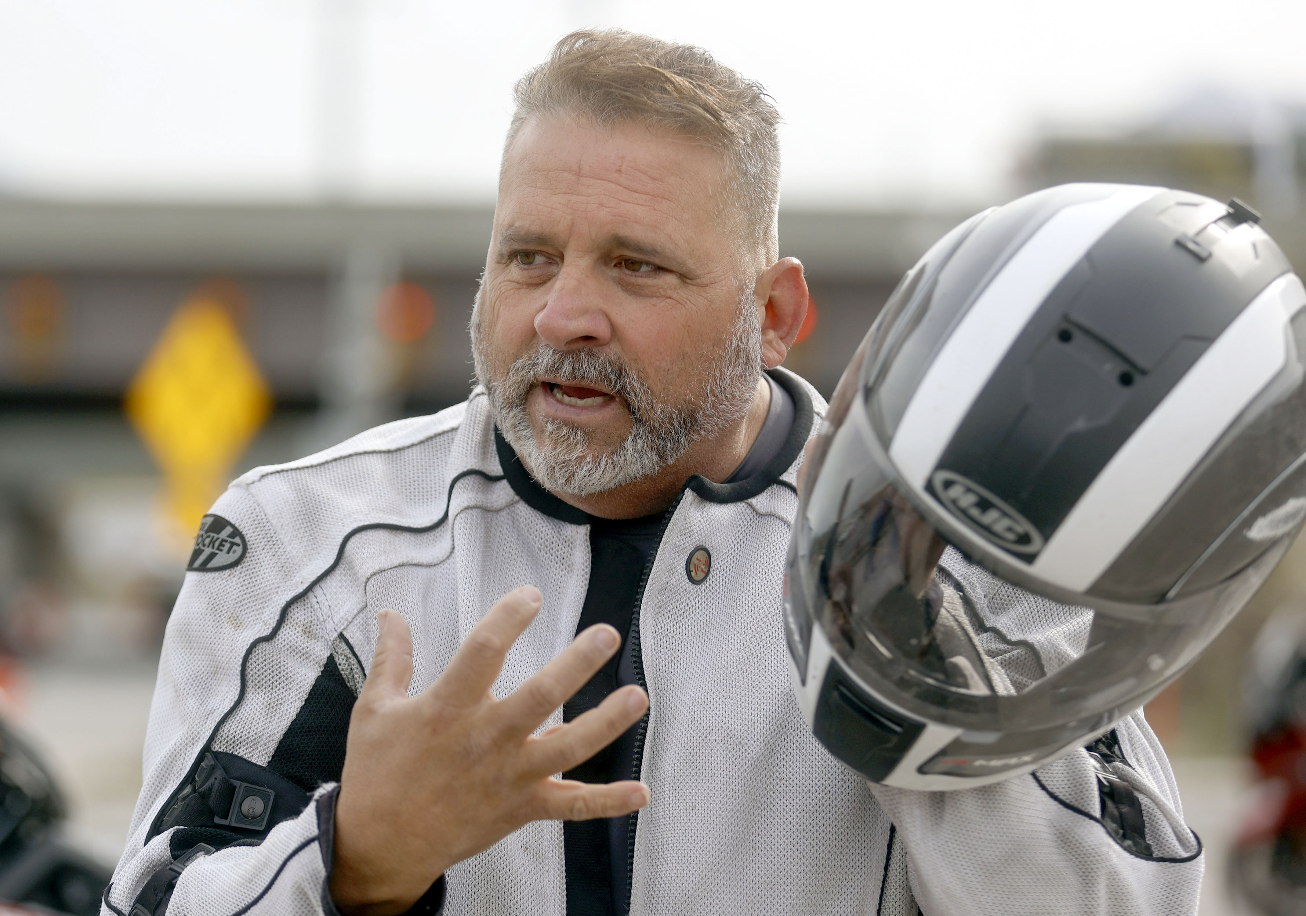 Joe Pereztalks about a motorcycle crash he was in during a press event to launch the Ride to Live motorcycle safety campaign outside of Harrison Eurosports in Sandy on Wednesday, April 21, 2021.