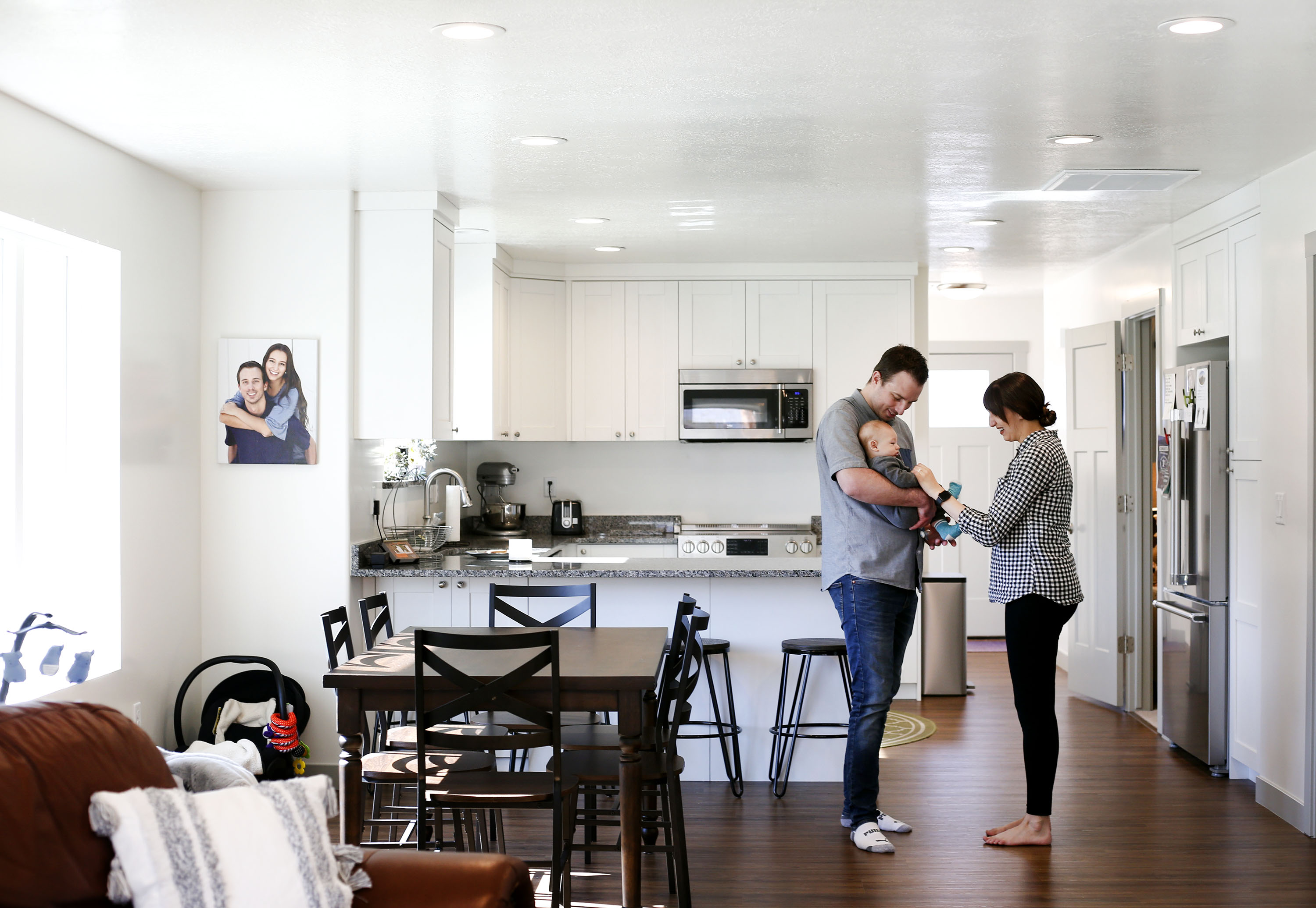 Mark, left, and Missy Haslam play with their son, Maverick, in their net-zero home in Ogden on Wednesday, April 27, 2021. The Weber State University-driven project took first place internationally for its energy performance in a fierce competition, beating out eight other teams.