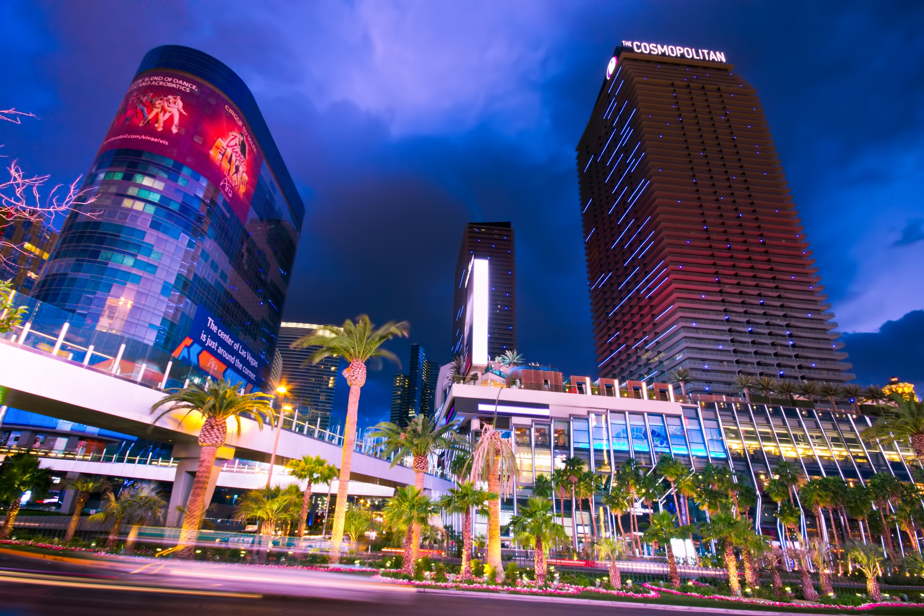 An empty hotel and a casino with the Las Vegas Strip in the foreground and dusk in the background