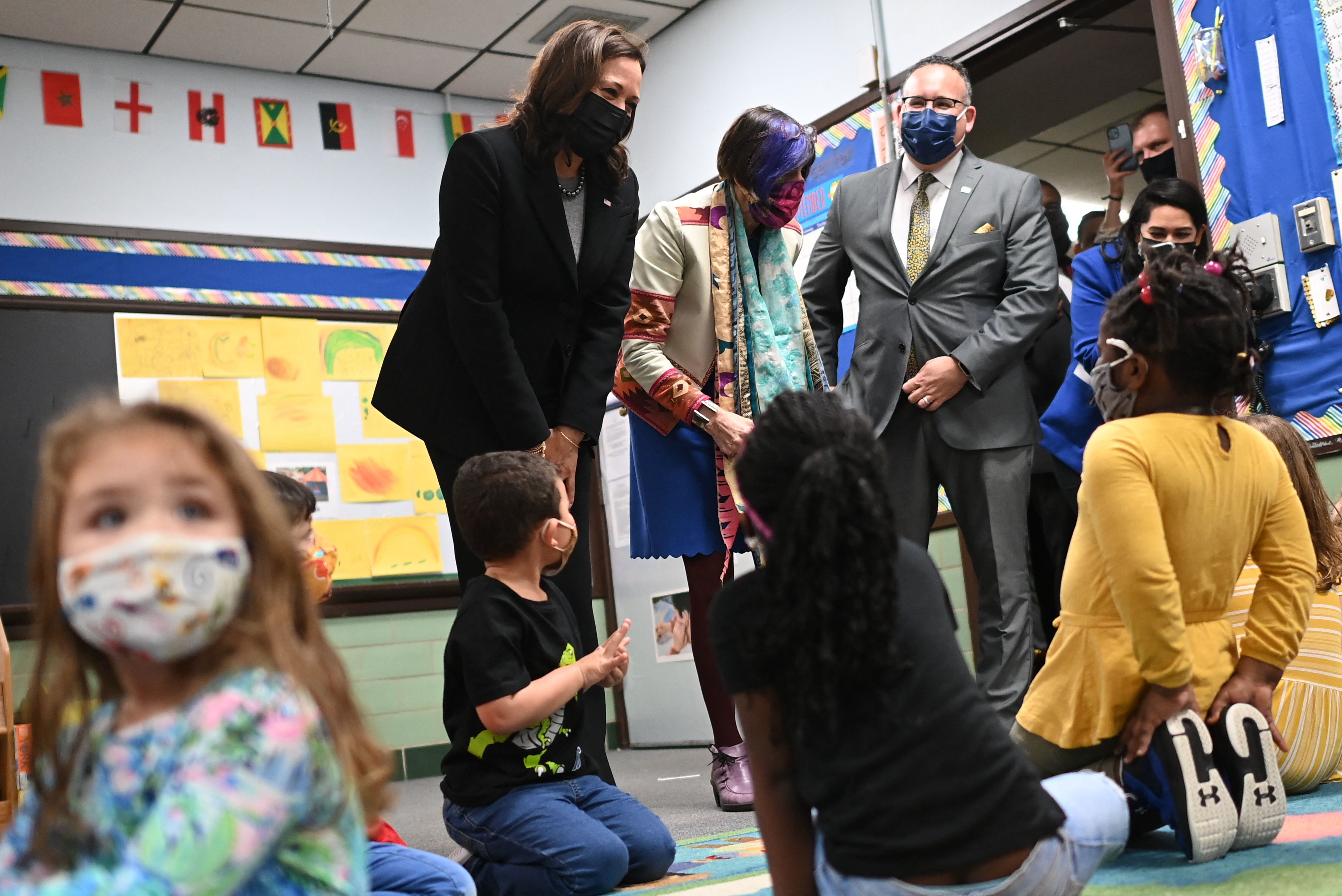 U.S. Vice President Kamala Harris, Education Secretary Miguel Cardona (R), and US Representative Rosa DeLauro (C) visit a classroom in the West Haven Child Development Center in West Haven, Connecticut on March 26, 2021.