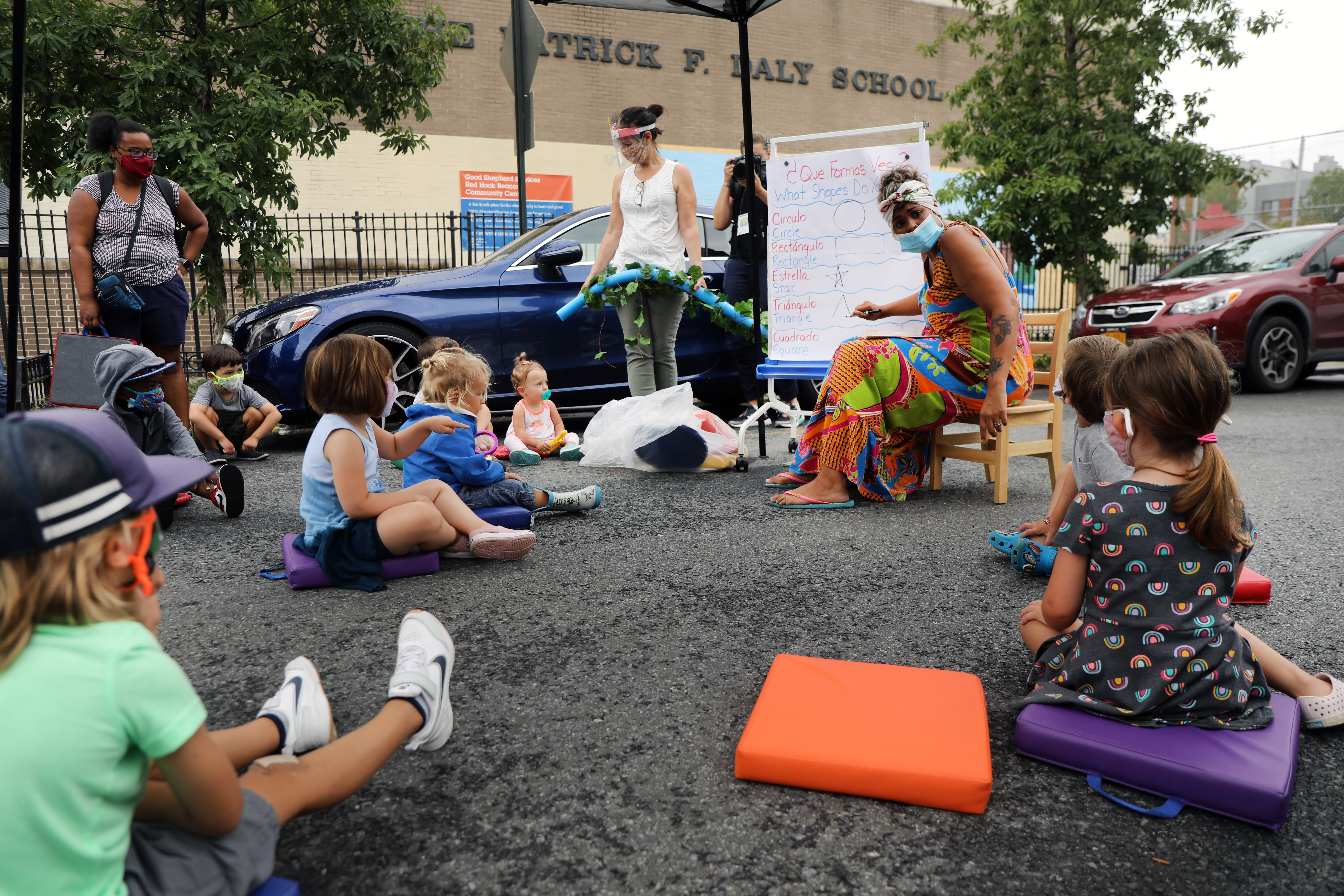 City council members, parents and students participate in an outdoor learning demonstration in front of a public school in the Red Hook neighborhood on September 02, 2020 in the Brooklyn borough of New York City.