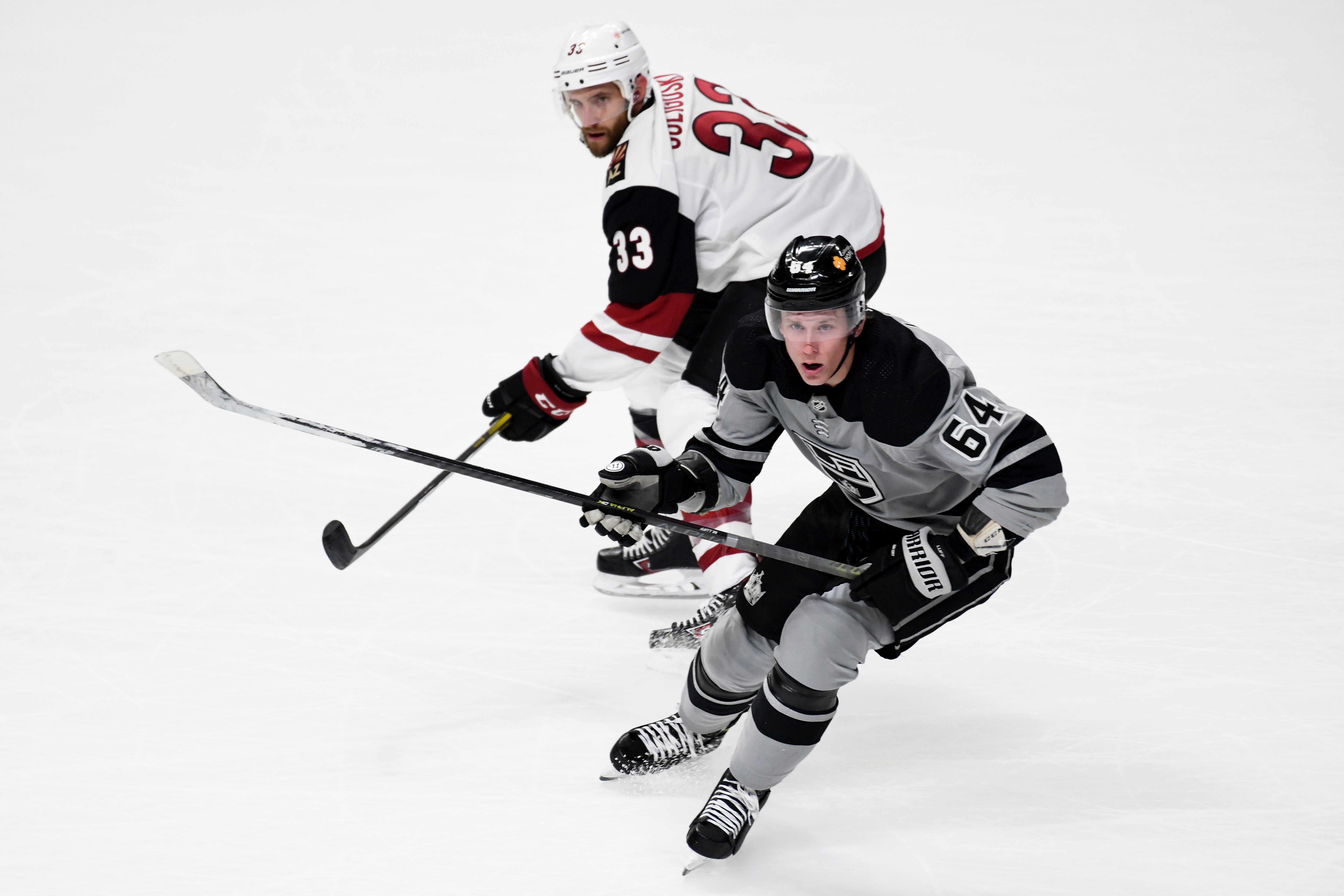 Los Angeles Kings Right Wing Matt Luff (64) and Arizona Coyotes Defenceman Alex Goligoski (33) watch play during NHL game between the Arizona Coyotes and the Los Angeles Kings on April 24, 2021, at the Staples Center in Los Angeles, CA.