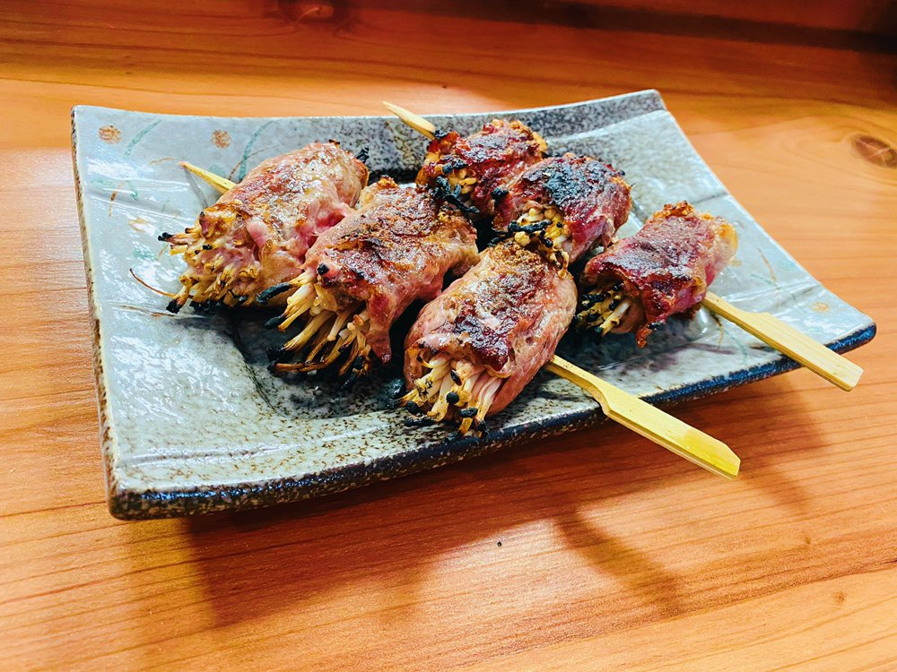 Beef-wrapped enoki skewers from Shokudou