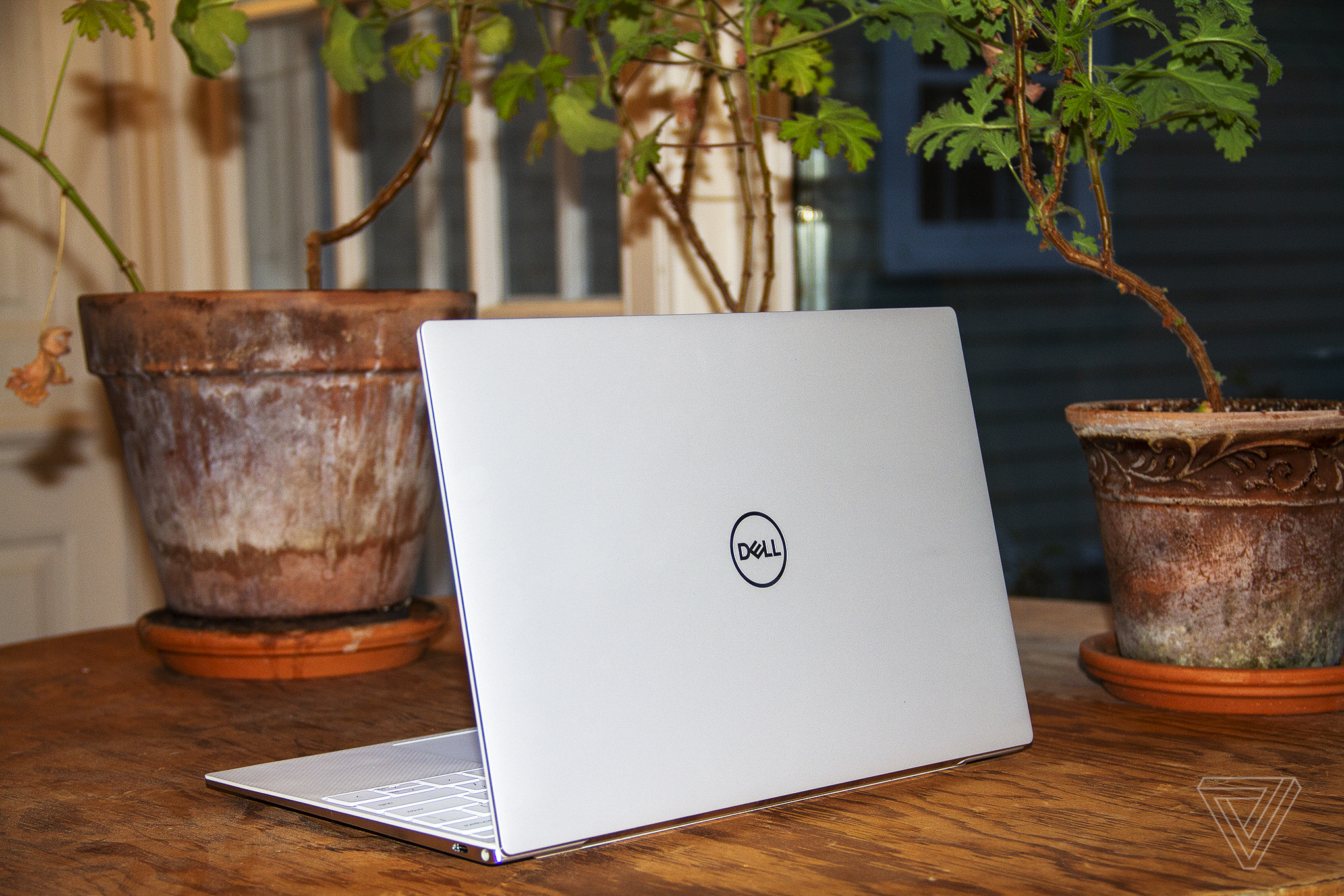 The Dell XPS 13 from the back, angled to the left.