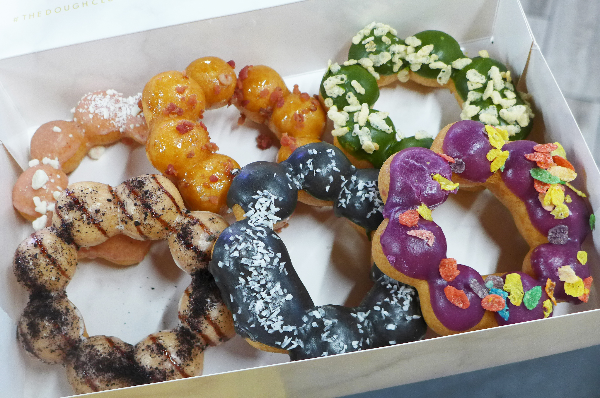 Since doughnuts made of conjoined balls in a box in a variety of garish colors.