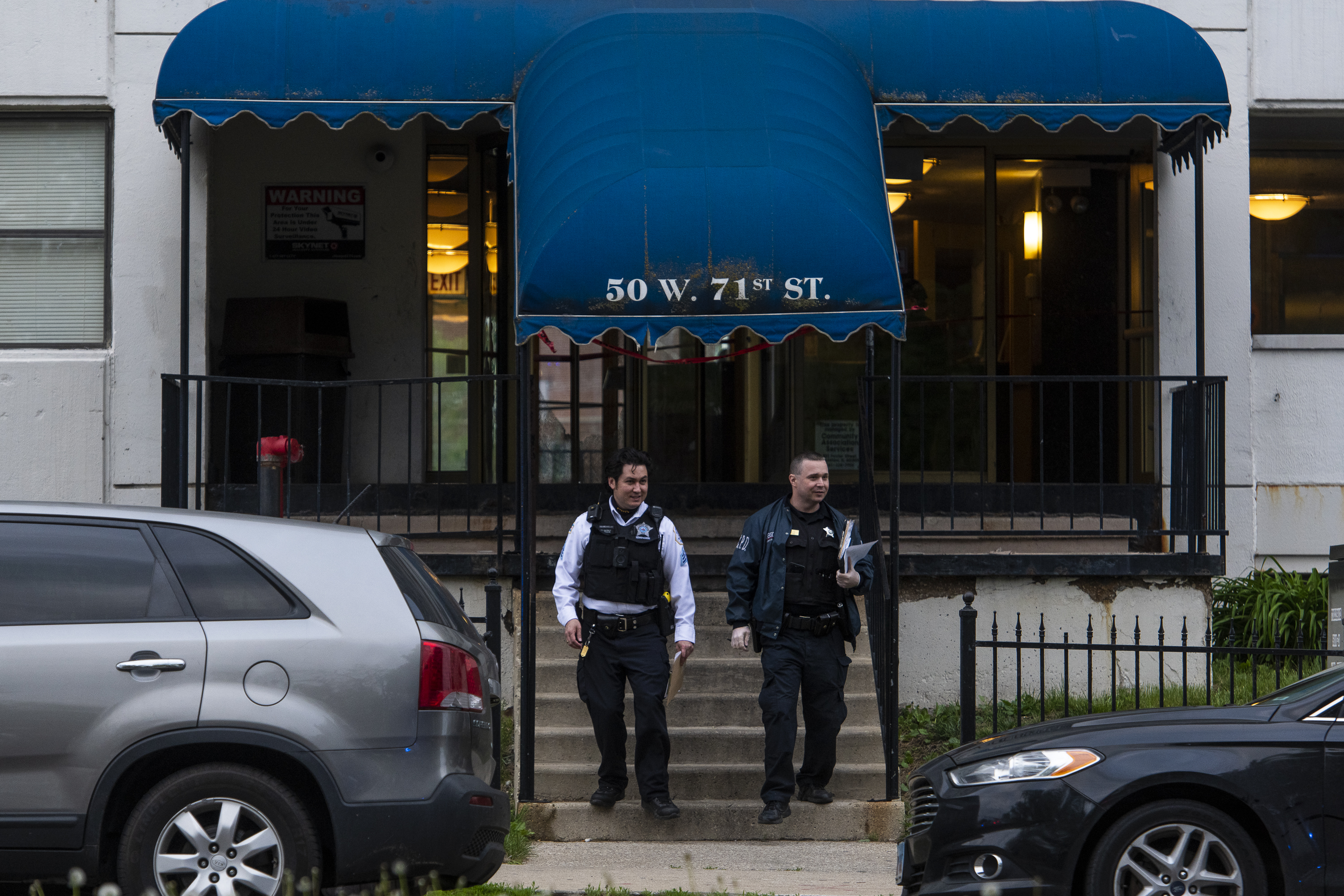 Chicago police work a scene where 2 people were shot, in the 7100 block of S Lafayette St. in the Park Manor neighborhood, Tuesday, May 4, 2021.