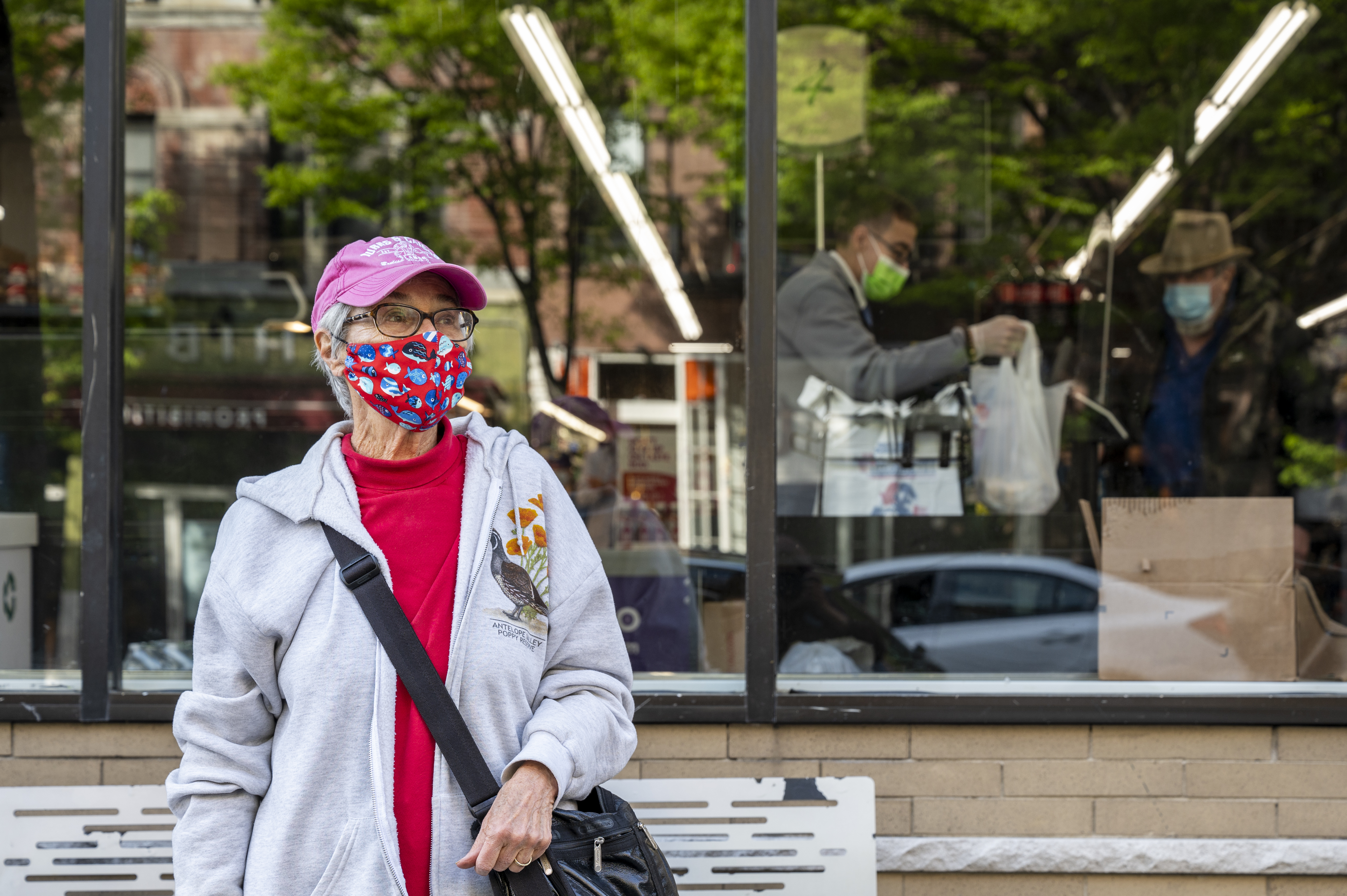 Judith Weis poses for a portrait outside of Gristedes in the Upper West Side where she has observed the staff ignoring the plastic bag ban implemented in 2020.