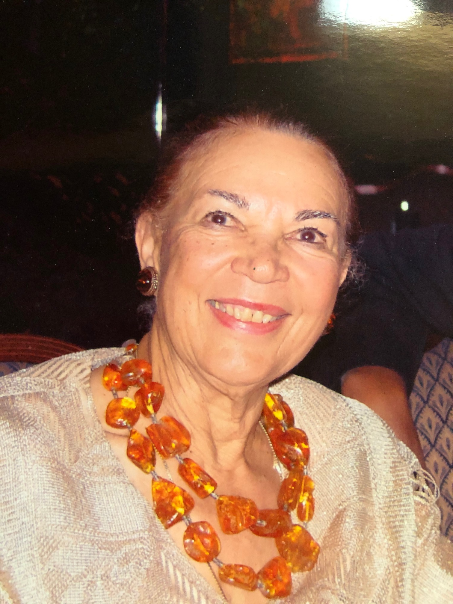Jetta Jones, smiling with an orange beaded necklace and a cream blouse. Jones lived the majority of her life in Hyde Park with her husband Dr. James Jones, used her love for art and her background as a lawyer to serve the city.