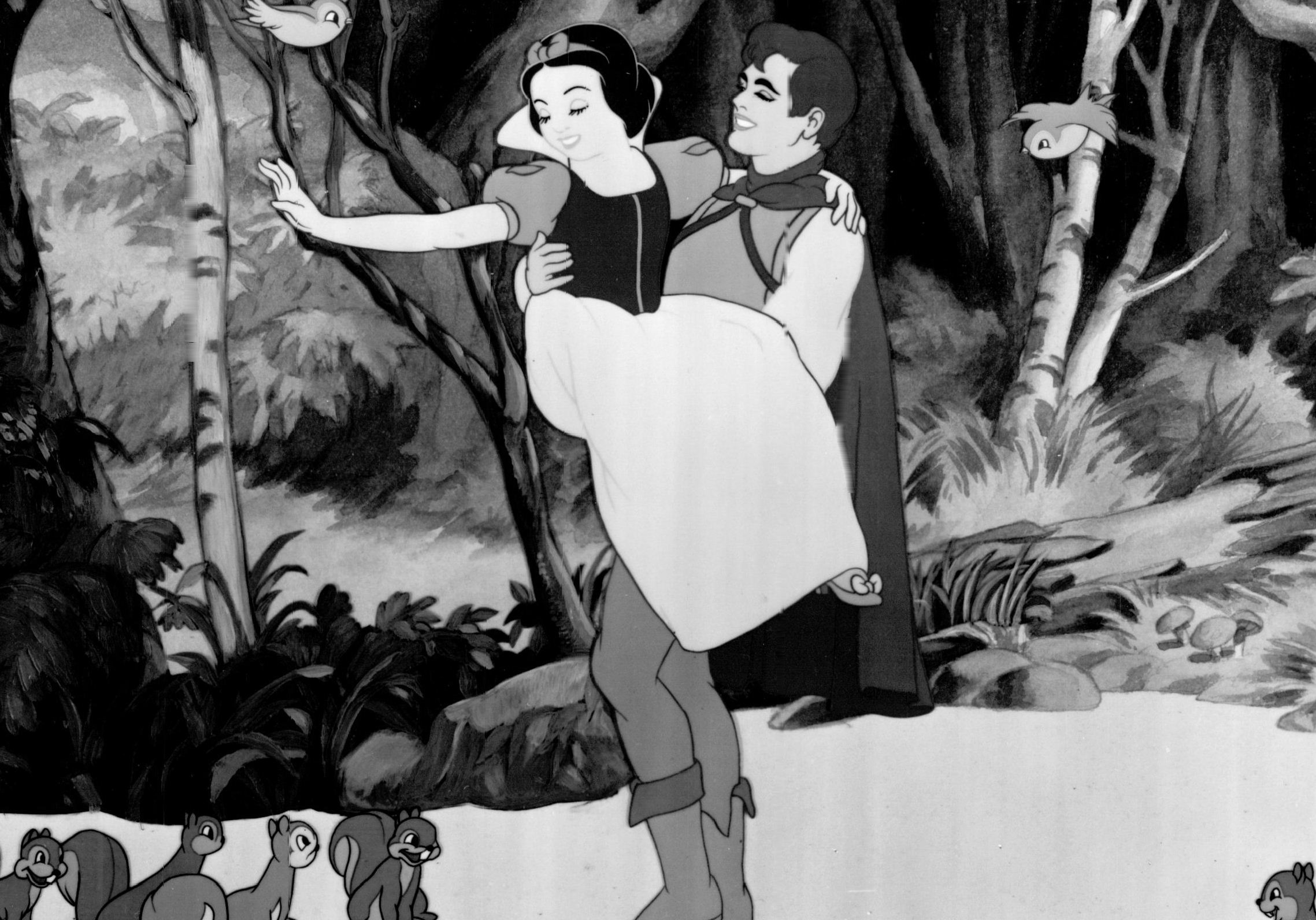 "Reunited with her true love, Snow White bids goodbye to her animal friends as the Prince carries her away in this scene from Walt Disney's first animated cartoon feature, ""Snow White and the Seven Dwarfs."""