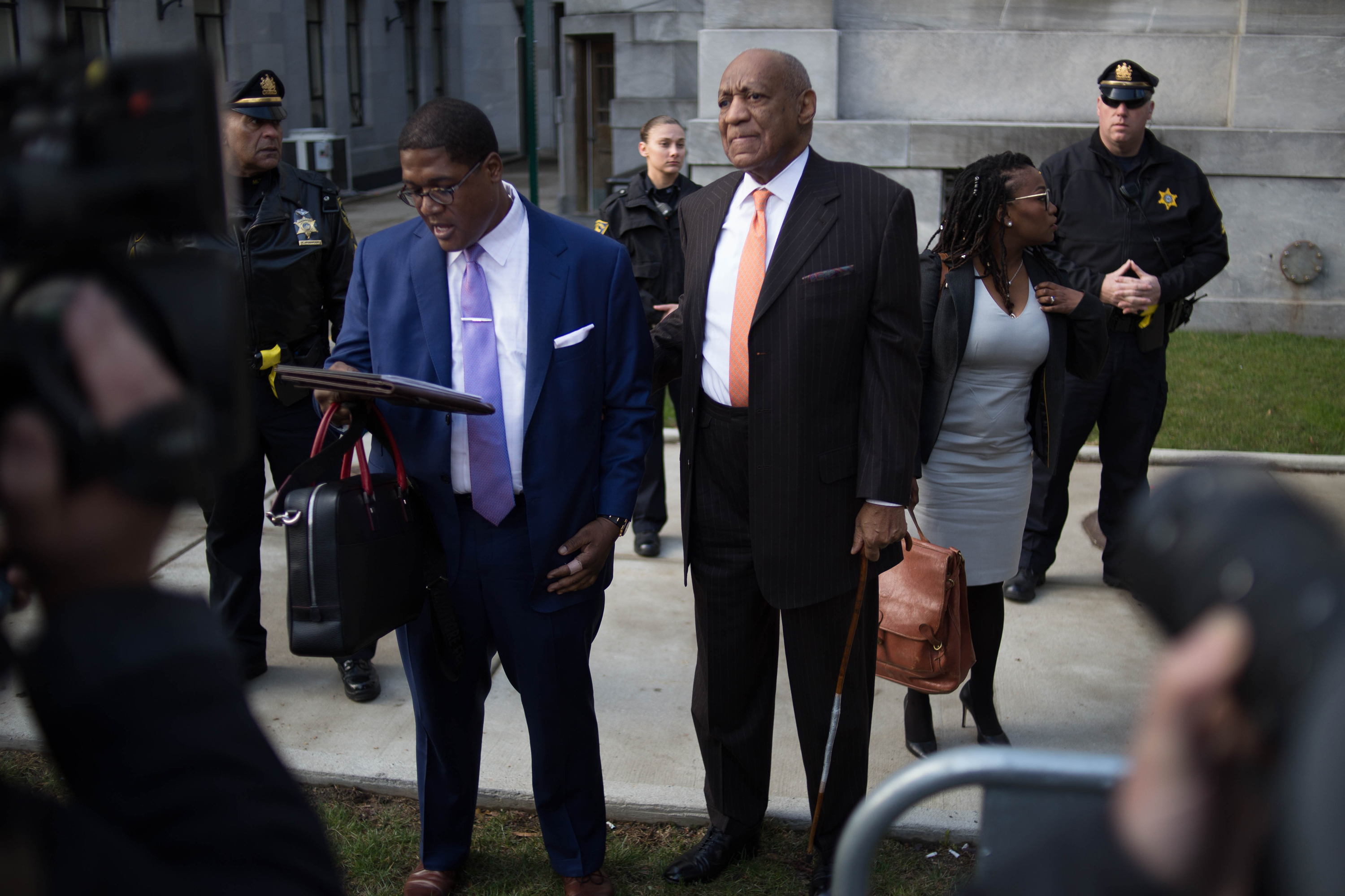 Actor Bill Cosby and spokesman Andrew Wyatt arrive for day two of Cosby's sexual assault re-trial at the Montgomery County Courthouse in Norristown, PA, April 10, 2018.