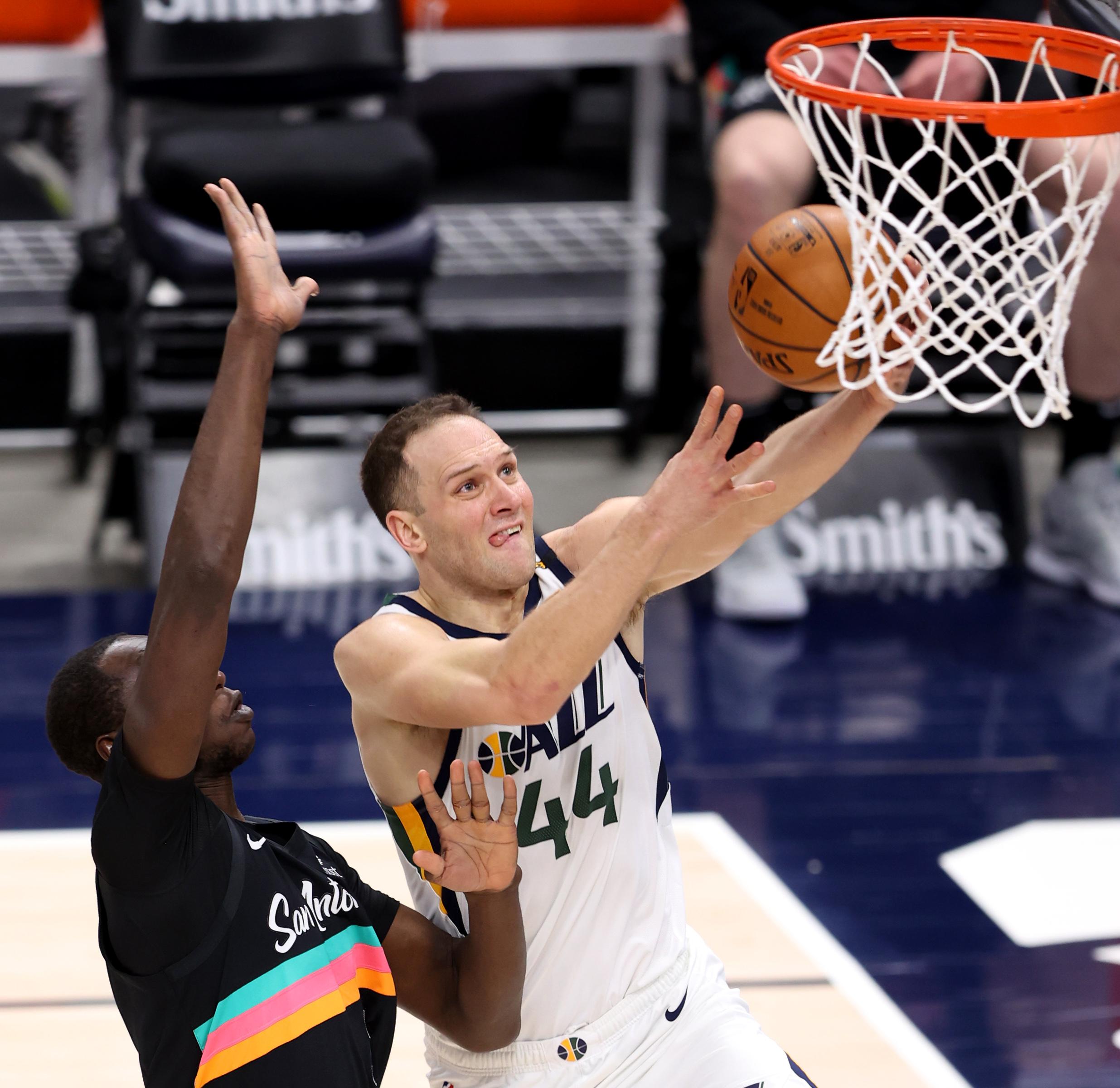 Utah Jazz forward Bojan Bogdanovic (44) puts in a shot with San Antonio Spurs center Gorgui Dieng (7) defending as the Utah Jazz and the San Antonio Spurs play an NBA basketball game at Vivint Arena in Salt Lake City on Wednesday, May 5, 2021.
