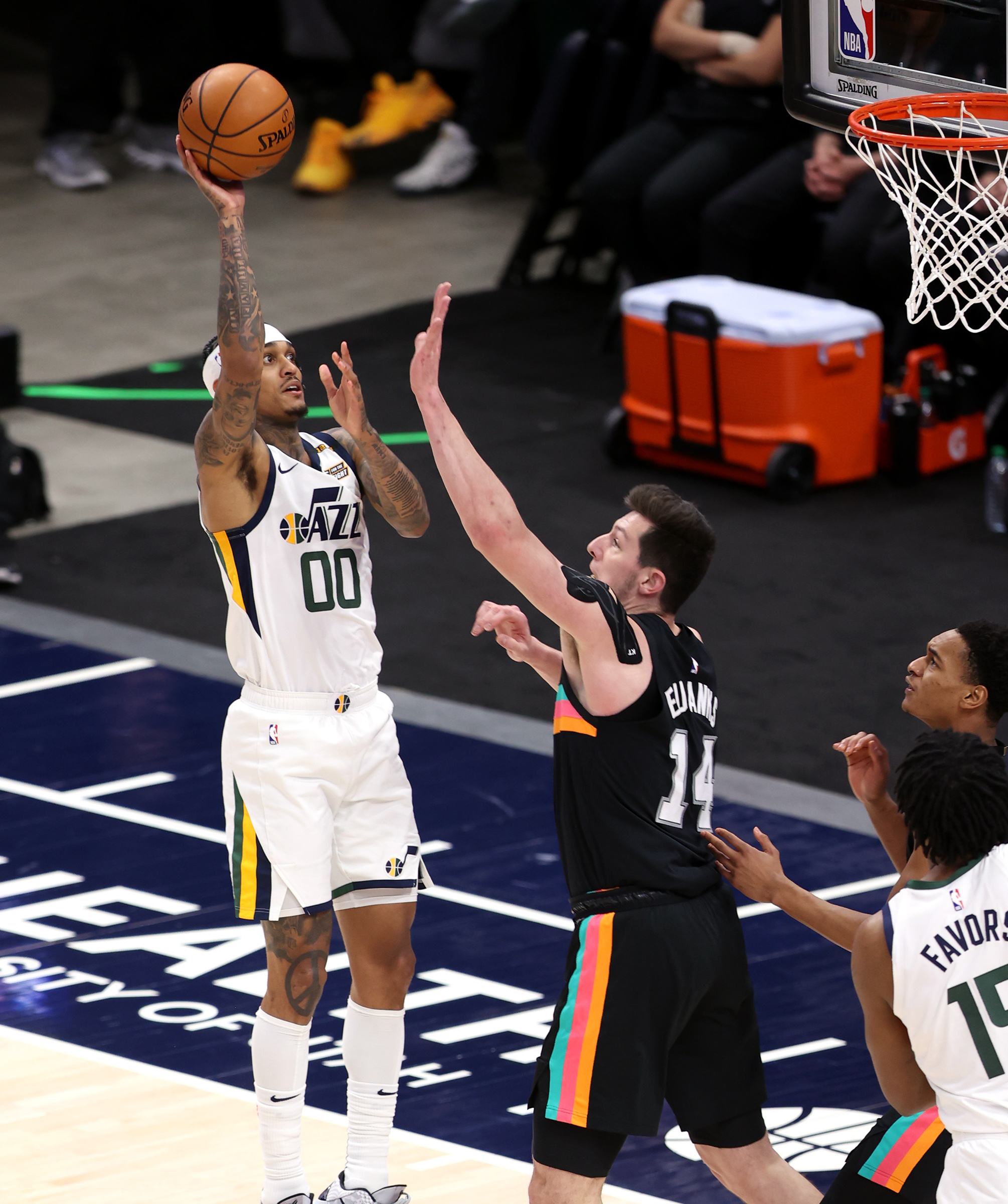 Utah Jazz guard Jordan Clarkson (00) pushes up a shot over San Antonio Spurs forward Drew Eubanks (14) as the Utah Jazz and the San Antonio Spurs play an NBA basketball game at Vivint Arena in Salt Lake City on Wednesday, May 5, 2021.