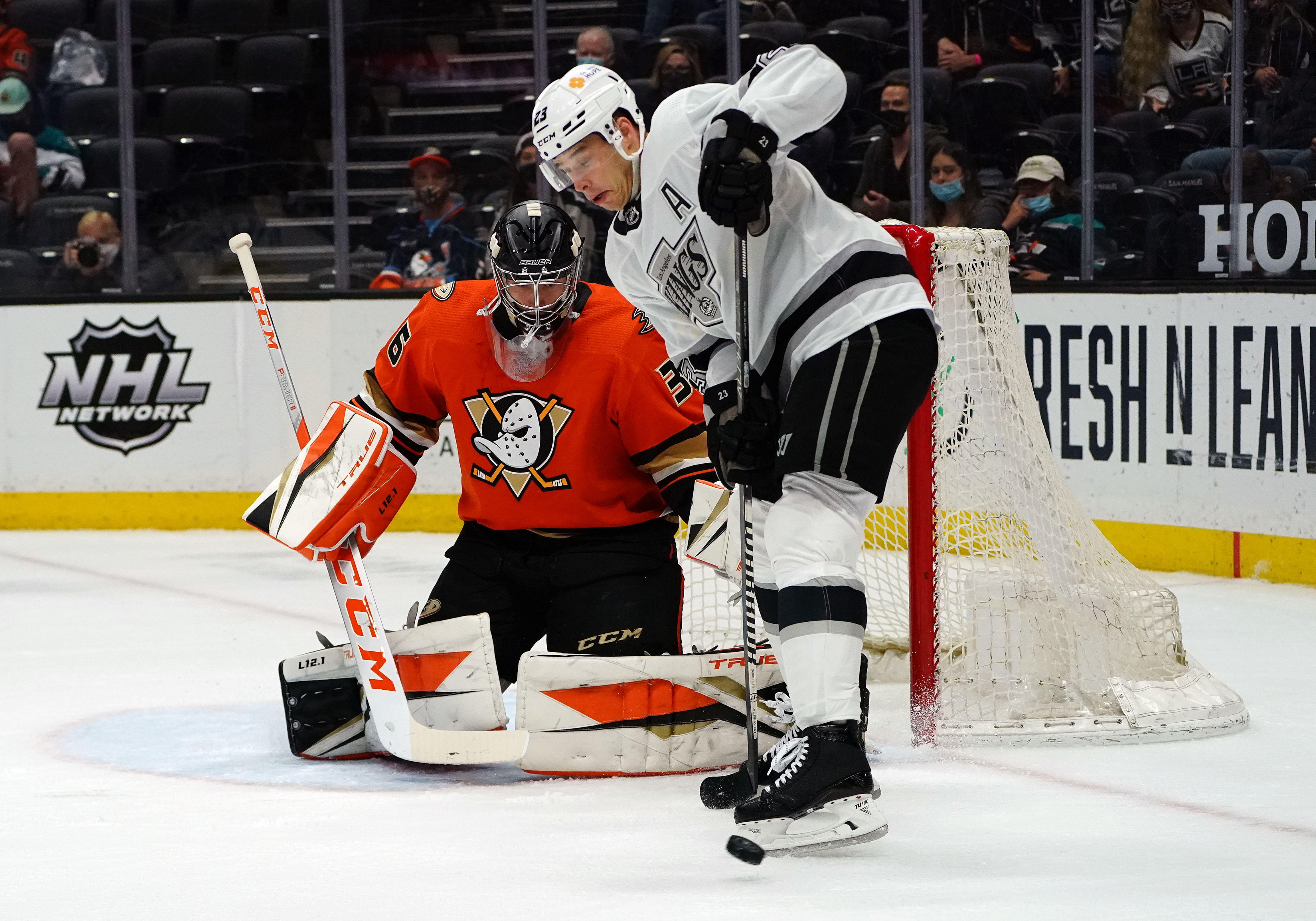 Los Angeles Kings right wing Dustin Brown (23) controls the puck in front of Anaheim Ducks goaltender John Gibson (36) during the third period at Honda Center.