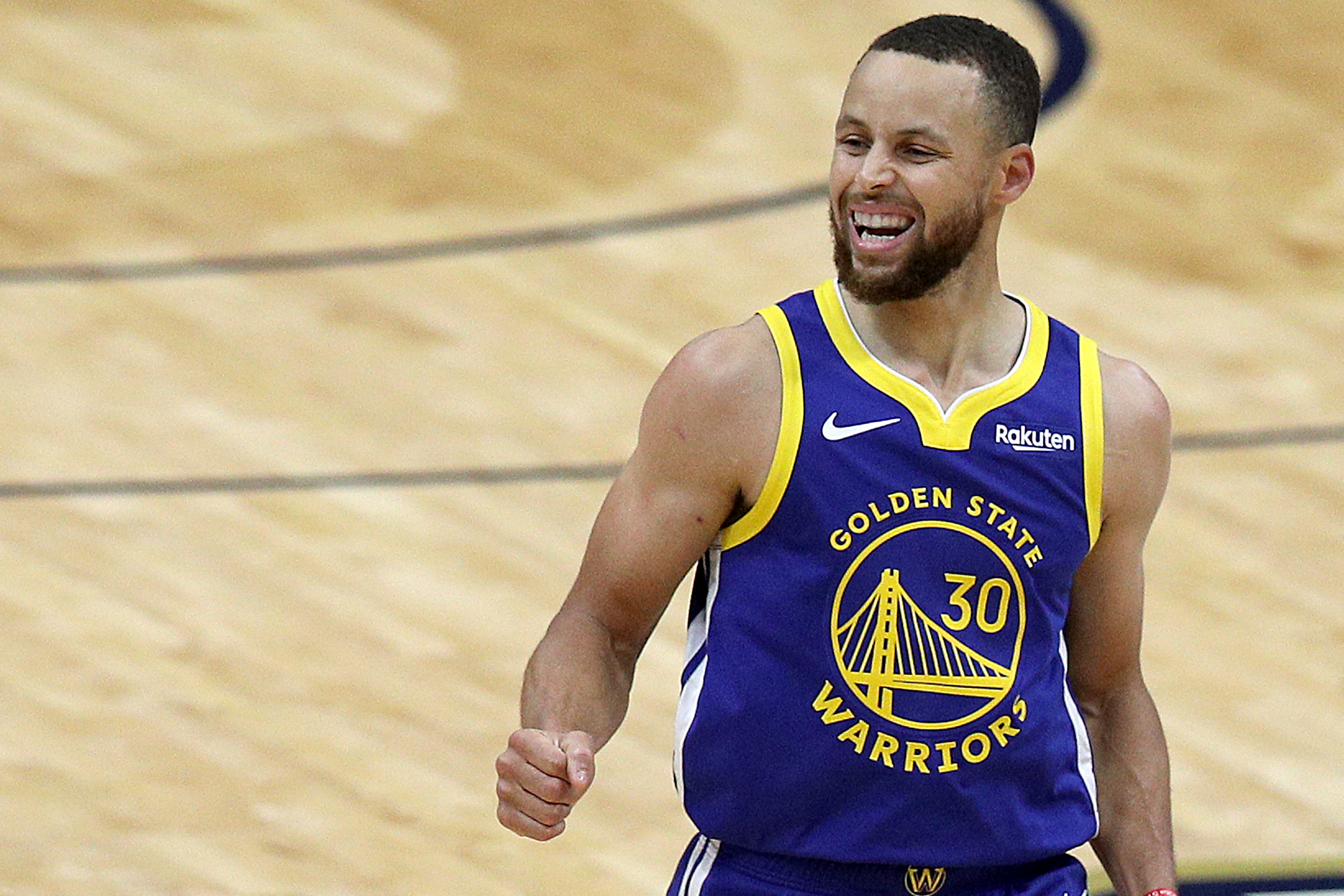Stephen Curry of the Golden State Warriors reacts after scoring a three point basket during the first quarter of an NBA game against the New Orleans Pelicans at Smoothie King Center on May 04, 2021 in New Orleans, Louisiana.