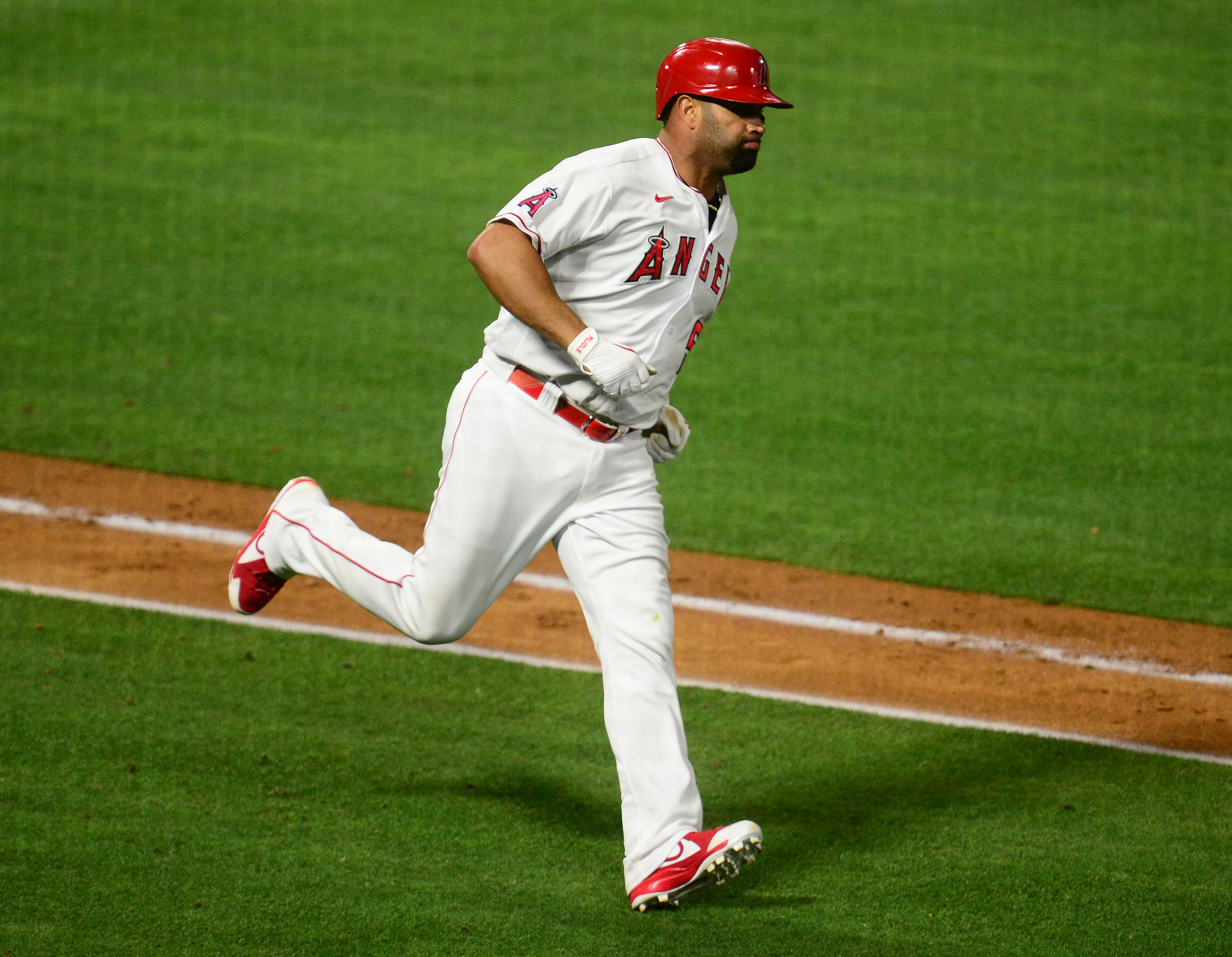 Los Angeles Angels first baseman Albert Pujols runs after hitting a single against the Tampa Bay Rays during the seventh inning at Angel Stadium.