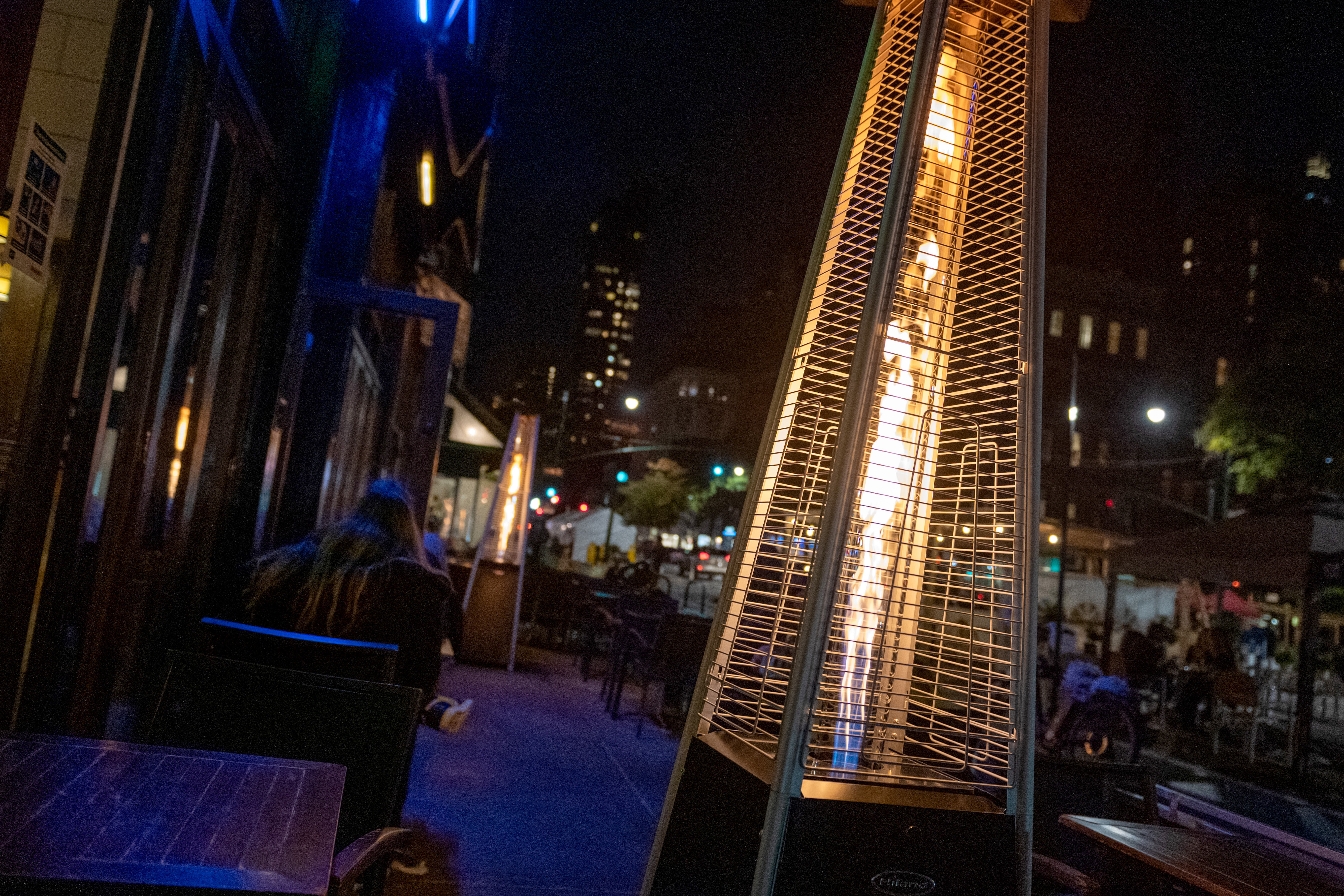 A gas heater is placed near outdoor tables at Tenzan restaurant on October 18, 2020 in New York City.