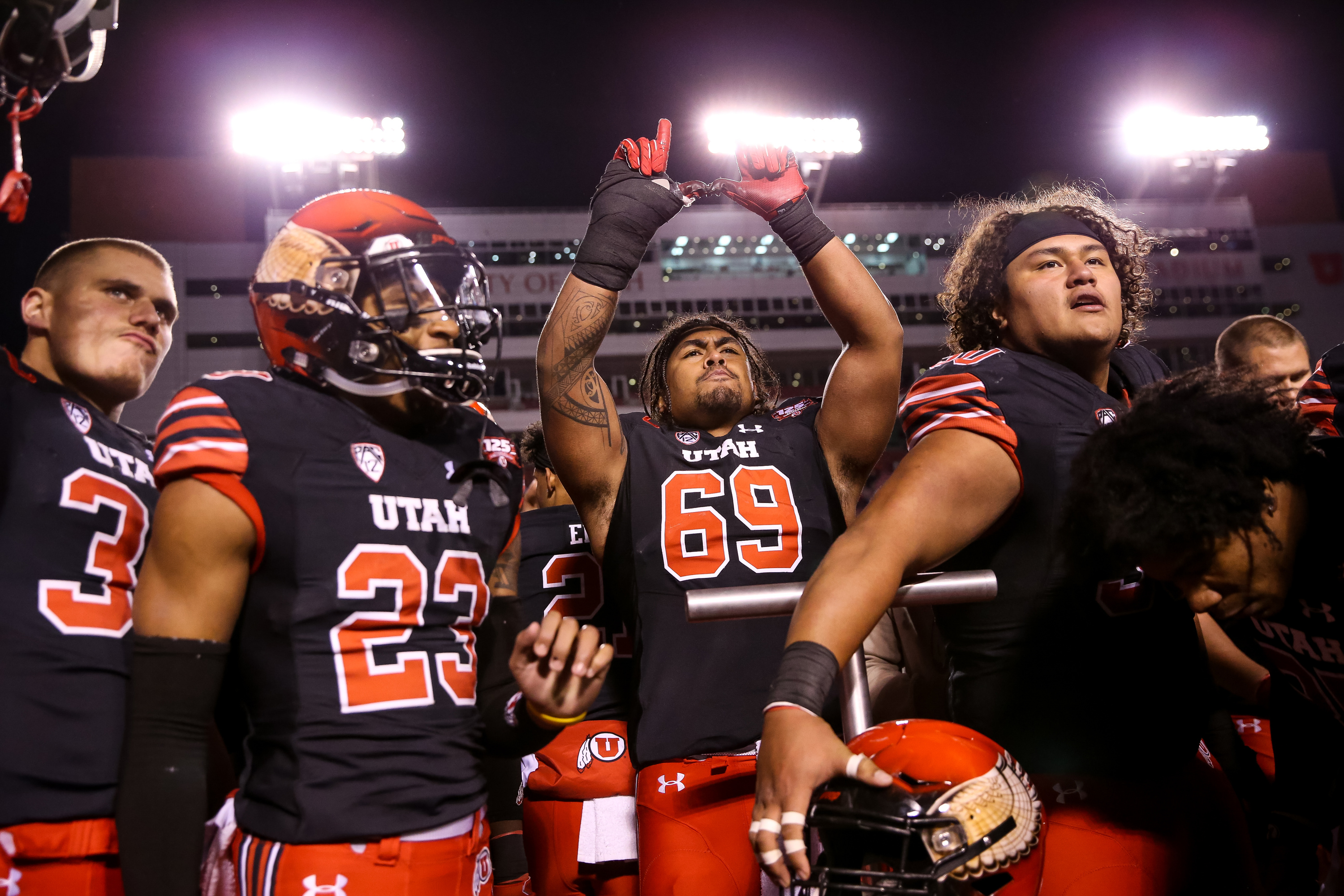 """Utah Utes offensive lineman Lo Falemaka (69) flashes the """"U"""" as he and teammates celebrate their win over the Oregon Ducks at Rice-Eccles Stadium in Salt Lake City on Saturday, Nov. 10, 2018."""