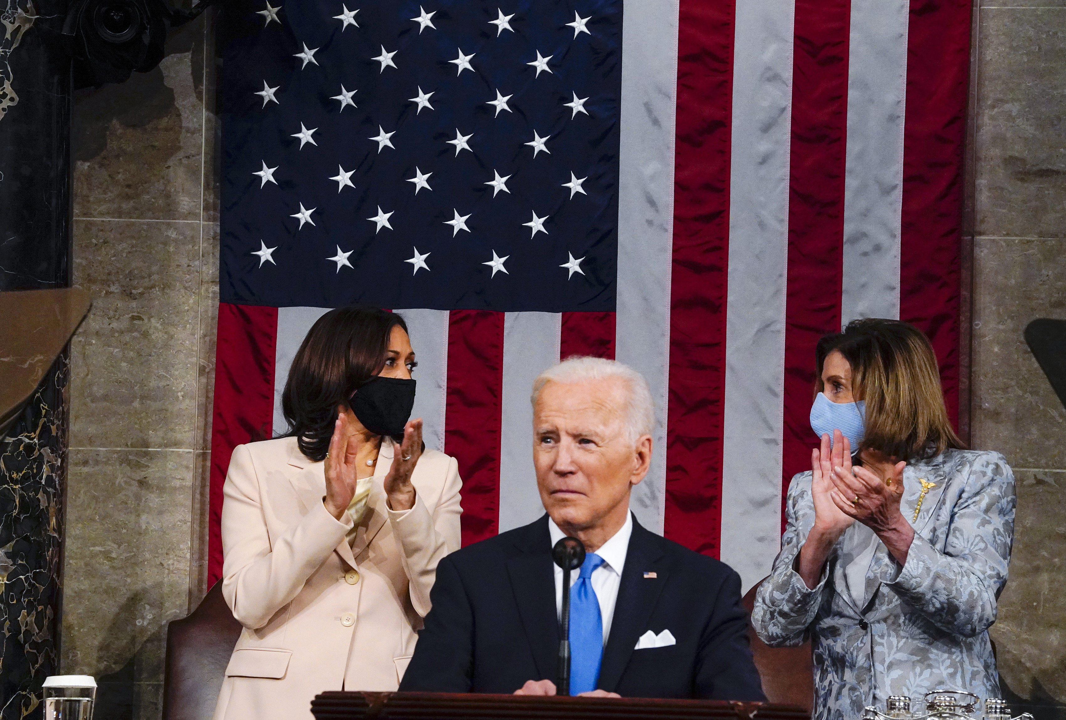 Vice President Kamala Harris and House Speaker Nancy Pelosi of Calif., look at each other as President Joe Biden addresses a joint session of Congress, Wednesday, April 28, 2021, in the House Chamber at the U.S. Capitol in Washington.