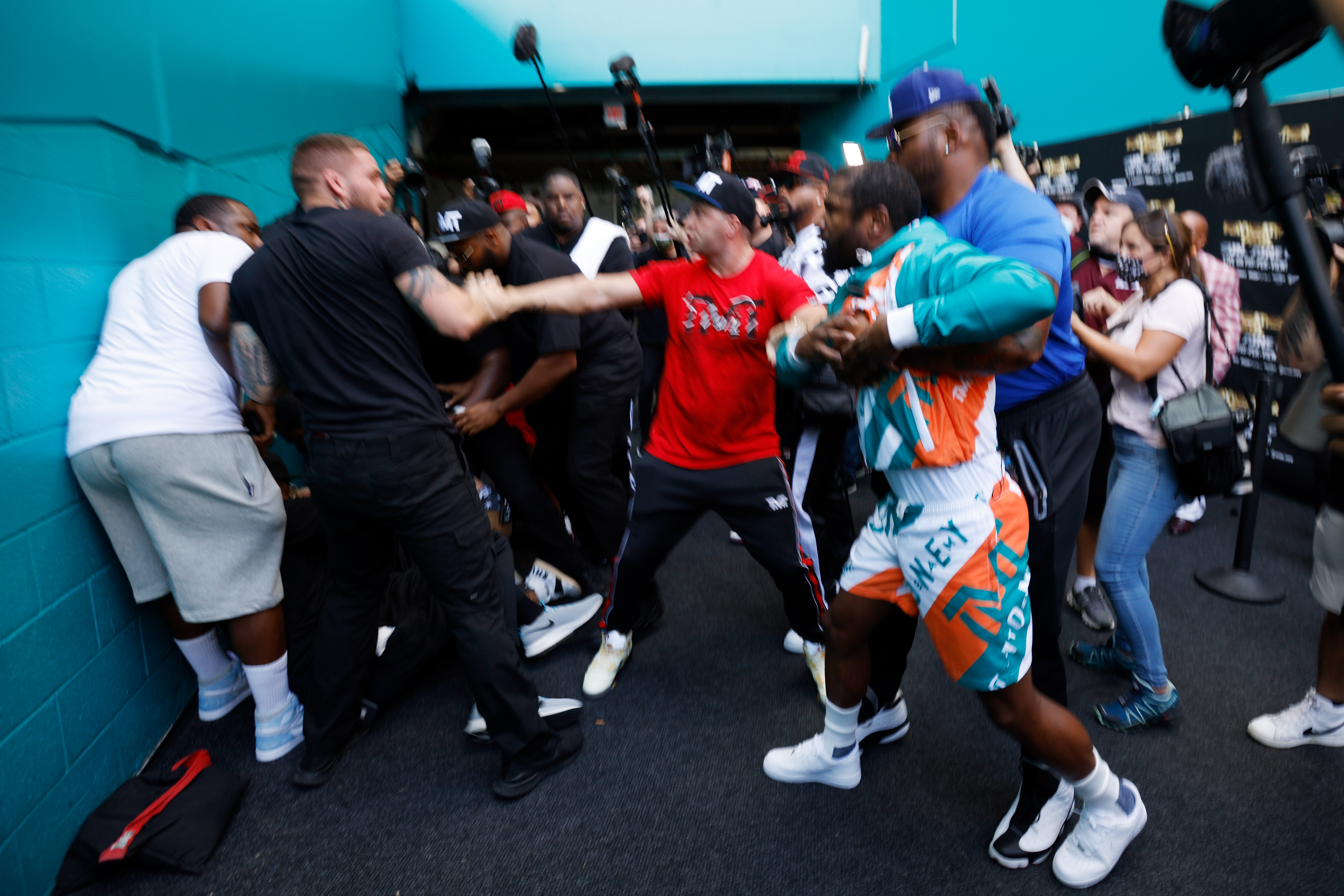 Floyd Mayweather and Jake Paul scuffle after Paul took Mayweather's hat during a media availability for Mayweather's fight against Logan Paul, brother of Jake Paul, at Hard Rock Stadium on May 06, 2021 in Miami Gardens, Florida.