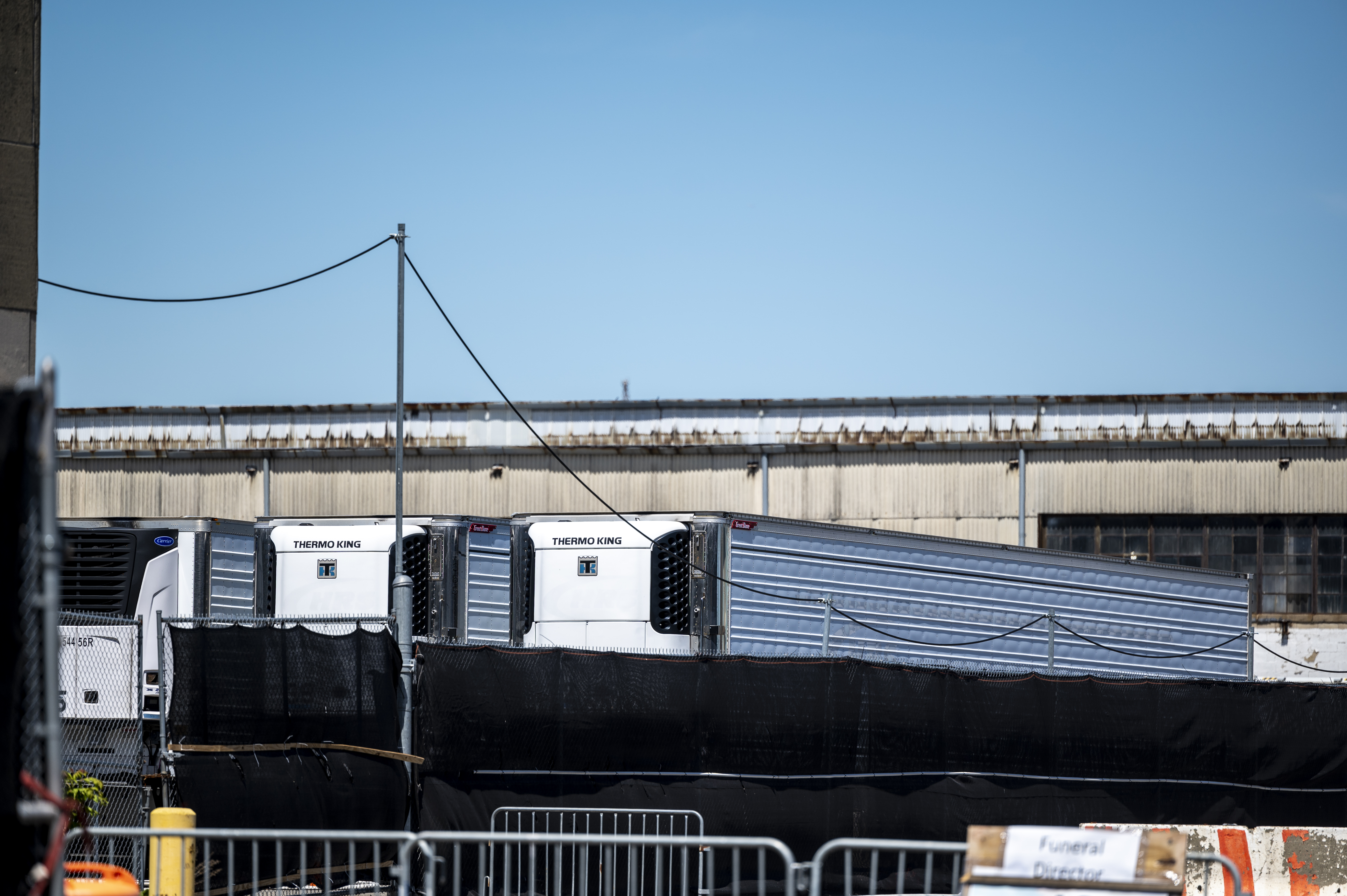 A fleet of refrigerated trucks storing the bodies of people who died of COVID-19 sits near the Brooklyn waterfront in Sunset Park on Thursday, May 6, 2021.