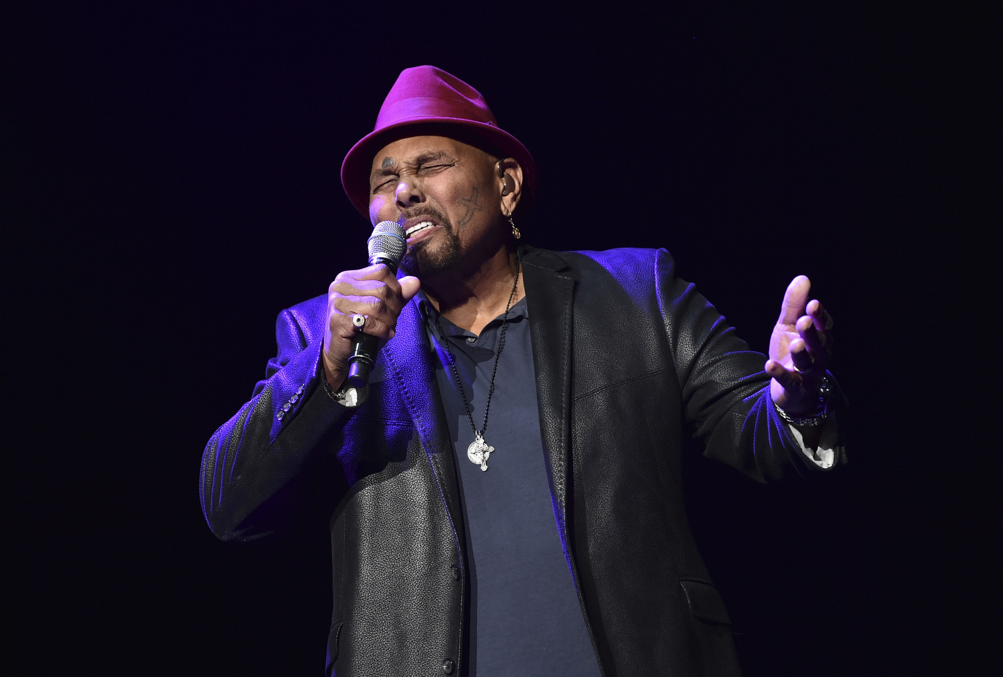 "Singer Aaron Neville performs during ""A Concert For Island Relief"" at Radio City Music Hall in New York, in 2018."