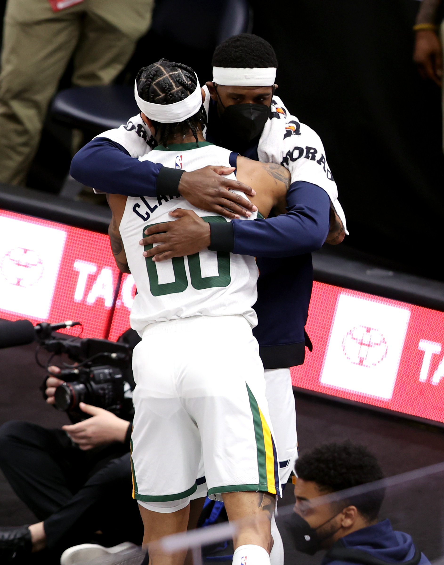 Utah Jazz guard Jordan Clarkson (00) gets a hug from teammate Utah Jazz forward Royce O'Neale (23) as he comes out of the game as the Utah Jazz and the San Antonio Spurs play an NBA basketball game at Vivint Arena in Salt Lake City on Wednesday, May 5, 2021. Utah won 126-94.
