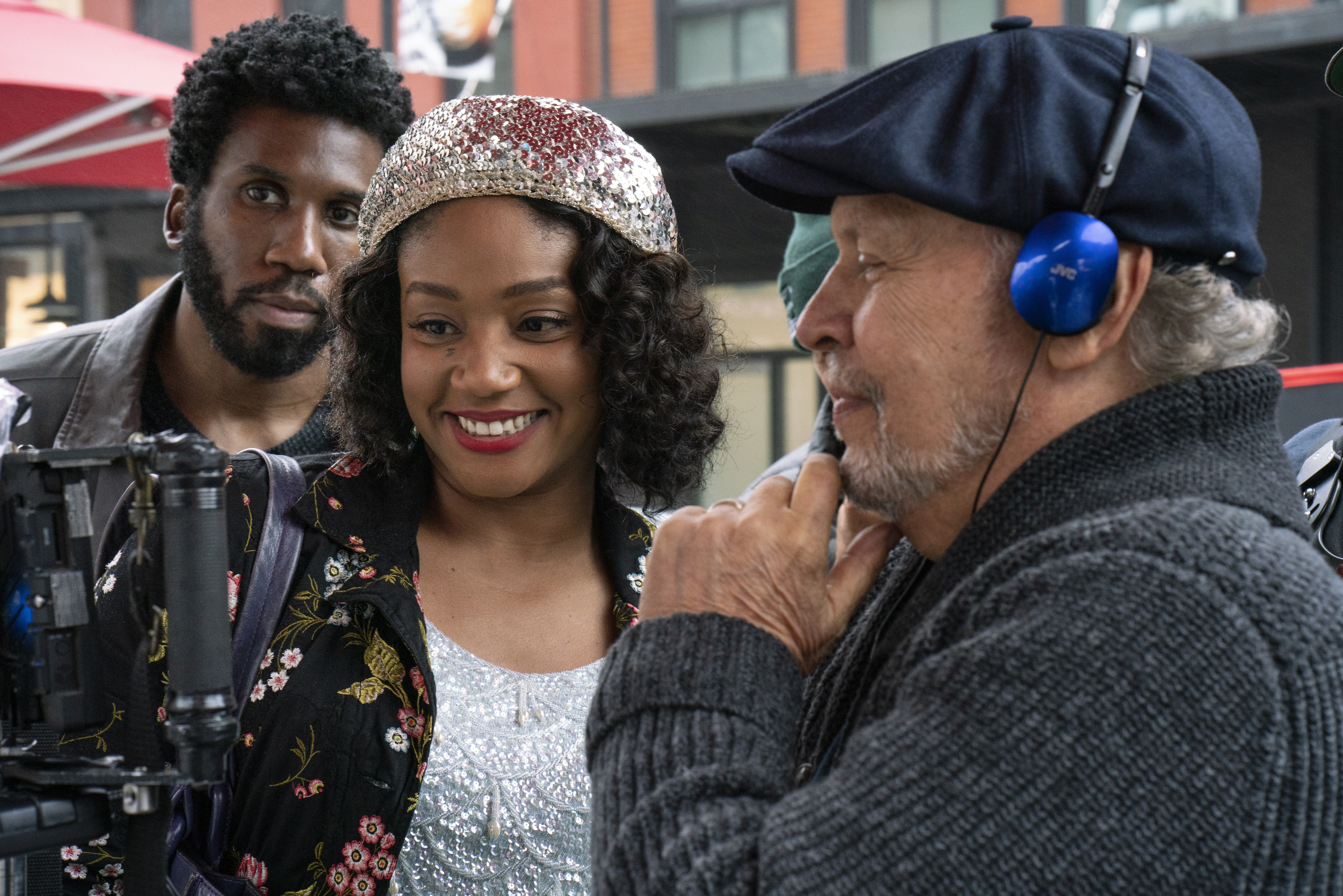 "Tiffany Haddish and director Billy Crystal watching footage on the set of ""Here Today."""