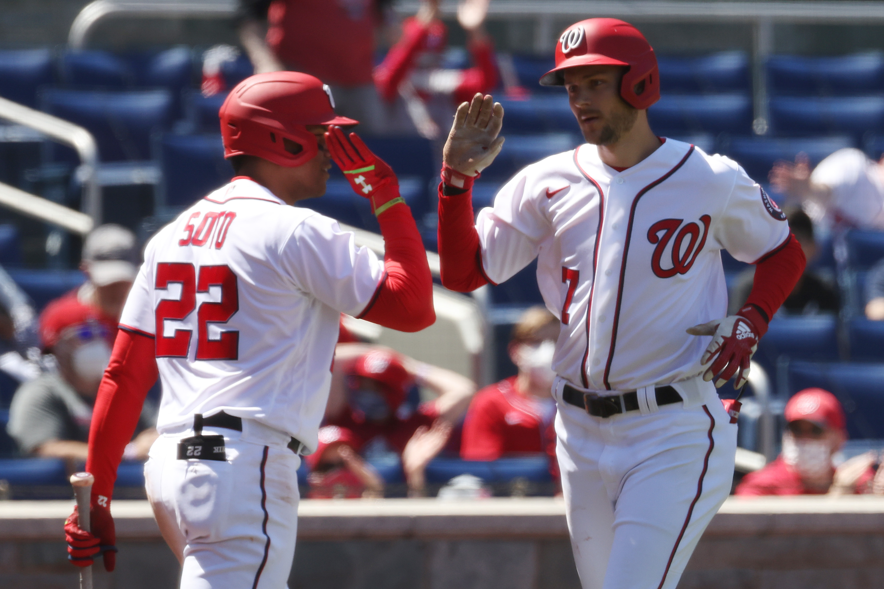 Washington Nationals shortstop Trea Turner celebrates with Nationals left fielder Juan Soto after hitting a home run against the Arizona Diamondbacks in the third inning at Nationals Park.