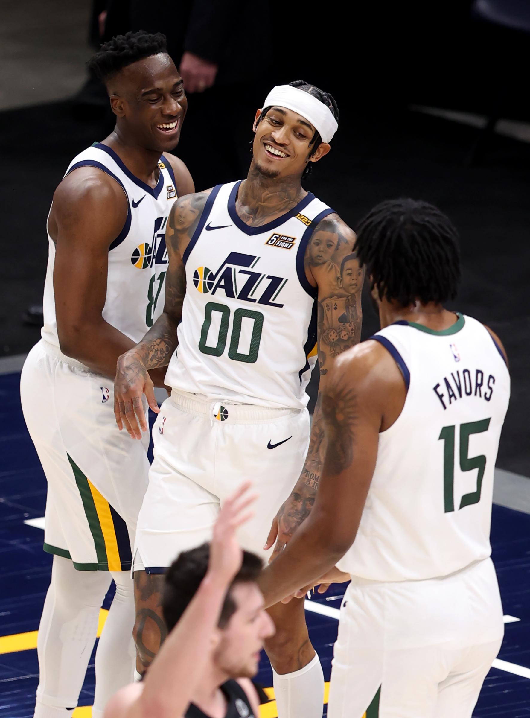 Utah Jazz guard Miye Oni (81) laughs with Utah Jazz guard Jordan Clarkson (00) after a circus shot as the Utah Jazz and the San Antonio Spurs play an NBA basketball game at Vivint Arena in Salt Lake City on Wednesday, May 5, 2021. Utah won 126-94.