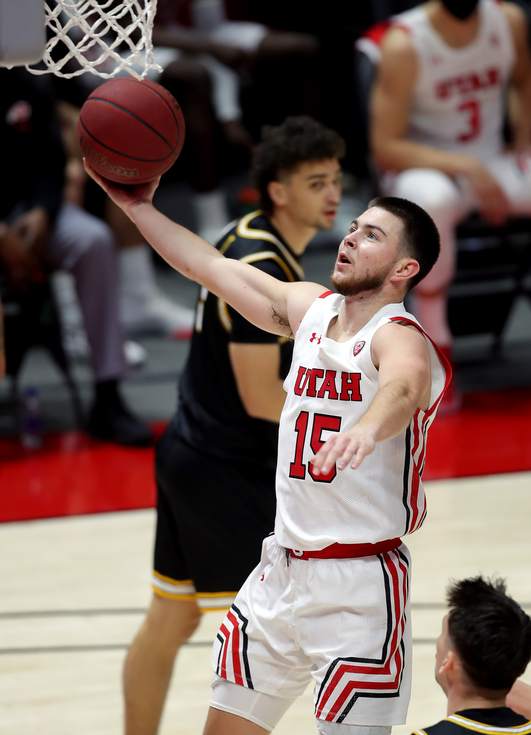Utah Utes guard Rylan Jones (15) goes up for a layup as the University of Utah and the University of Idaho play a basketball game at the Huntsman Center in Salt Lake City on Friday, Dec. 18, 2020.