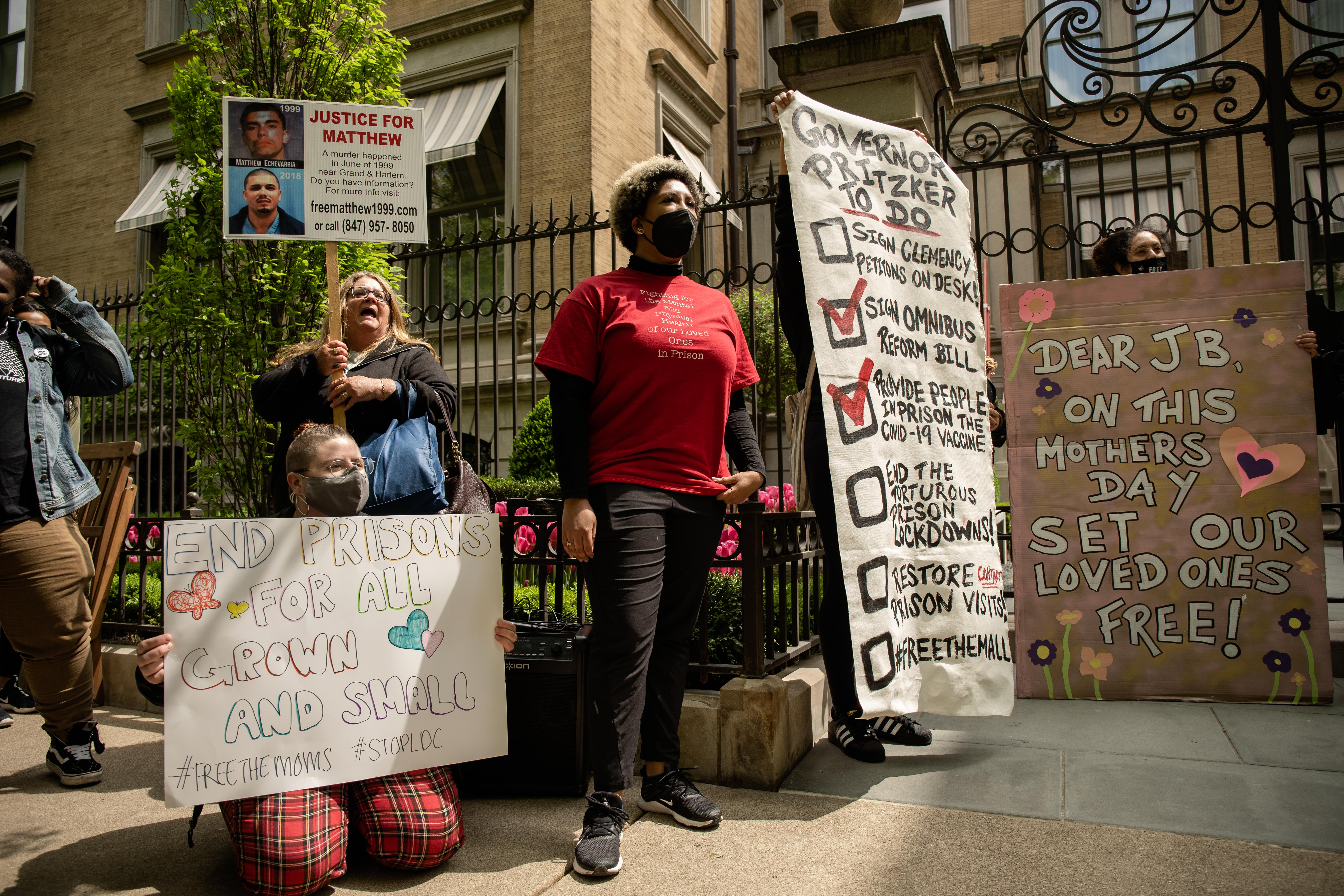 Mothers of incarcerated people, joined by other prisoners' rights advocates, stand in front of Gov. J.B. Pritzker's home in Lincoln Park on Friday morning, May 7, 2021. They demanded Gov. Pritzker to resume contact visits in Illinois prisons, sign clemencies and stop the construction of the Illinois Youth Center.