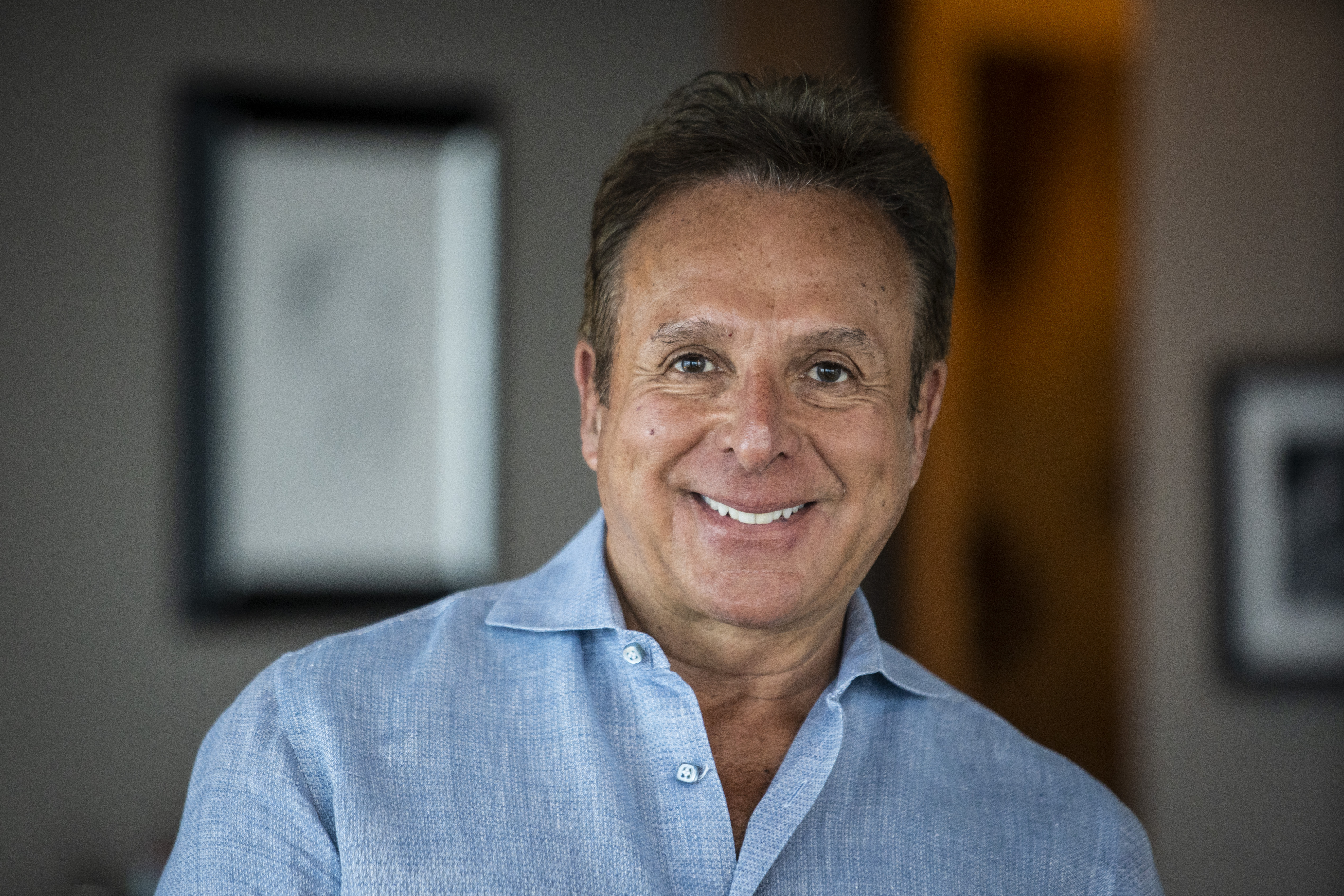 Mark Giangreco poses inside his South Loop home on May 4.