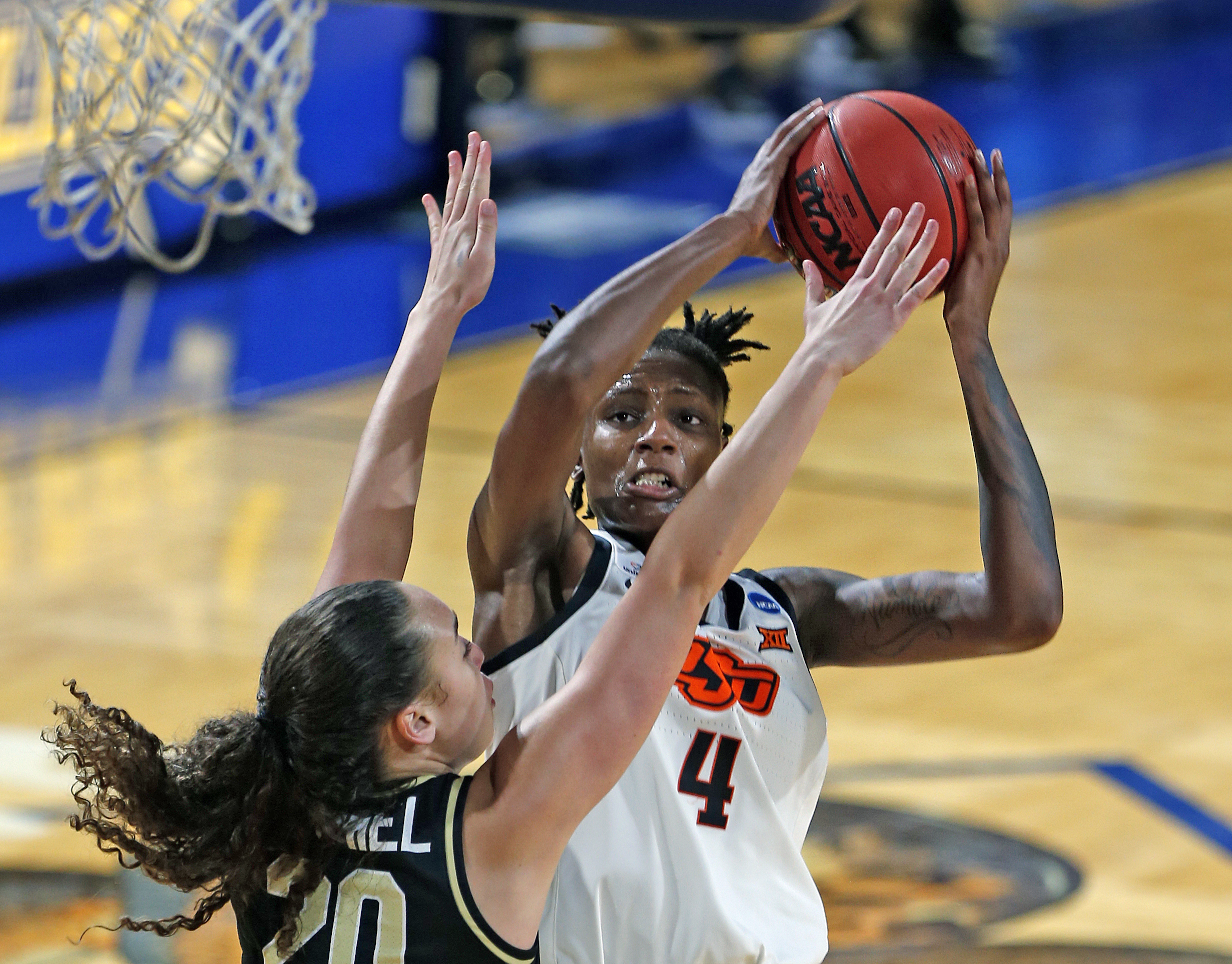 Oklahoma State forward Natasha Mack(4) shoots over Wake Forest forward Christina Morra(23) during the second half of a college basketball game in the first round of the women's NCAA tournament at the Greehey Arena in San Antonio, Texas, Sunday, March 21, 2021.