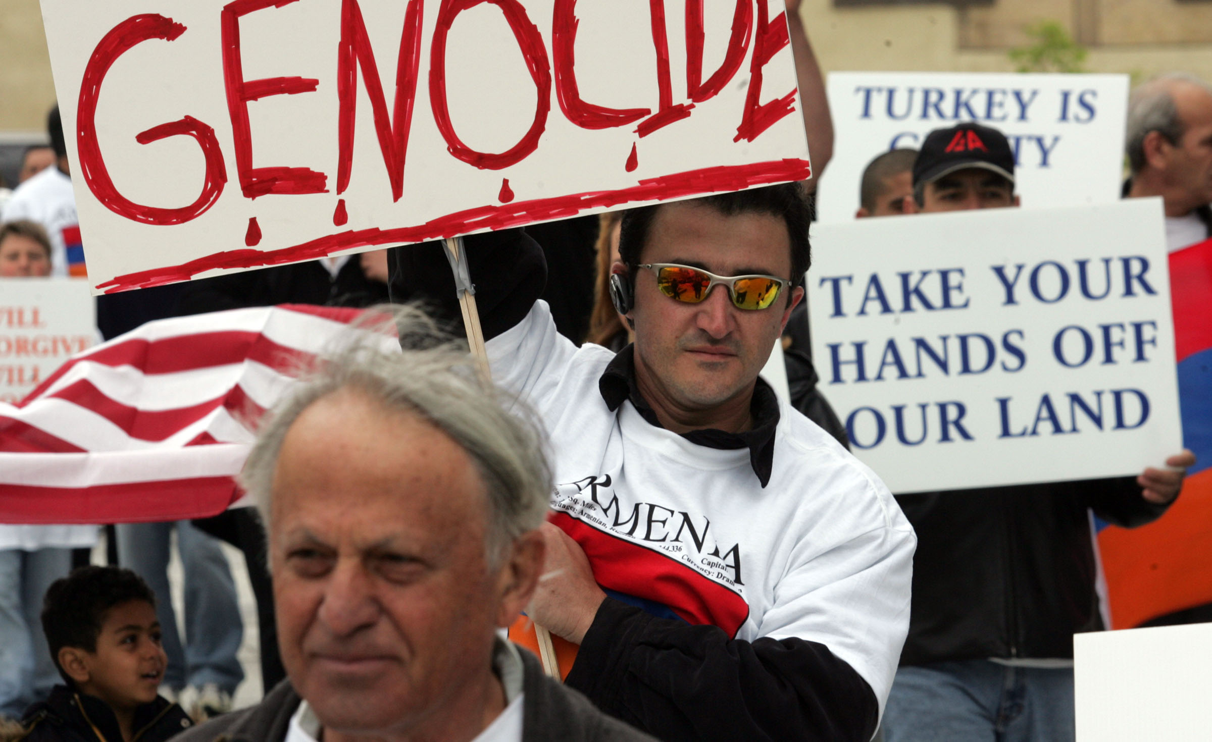 Kevork Joulhayan marches with others from the Armenian community during a demonstration at the Bennett Federal Building in Salt Lake City to mark the anniversary of the Ottoman Empire's slaughter of over one million Armenians in 1915. Joulhayan is a second generation survivor of the genocide, which is still not acknowledged by the Turkish government. Photo by Jason Olson
