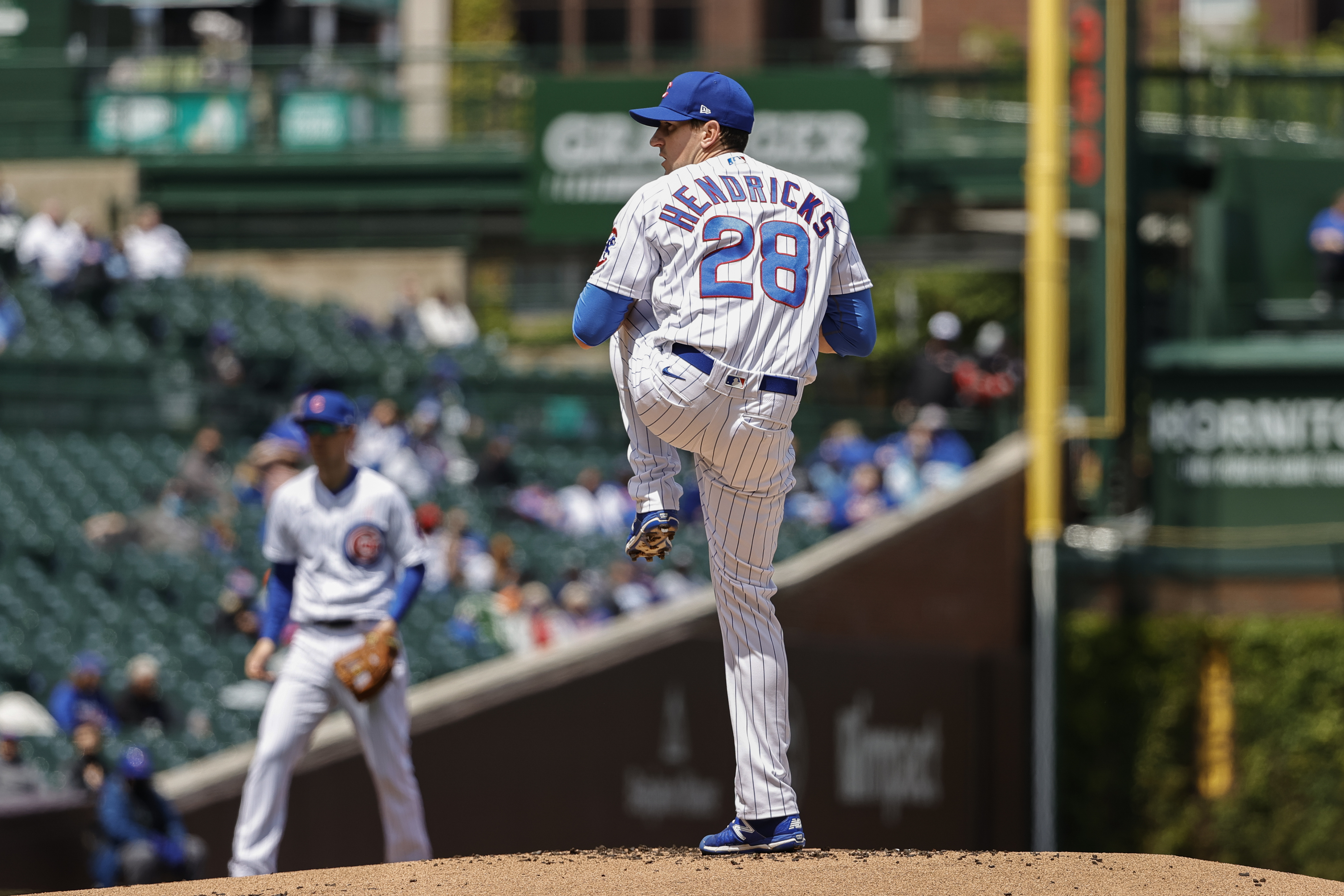 Cubs starting pitcher Kyle Hendricks delivers against the Pirates during the first inning of Sunday's game.
