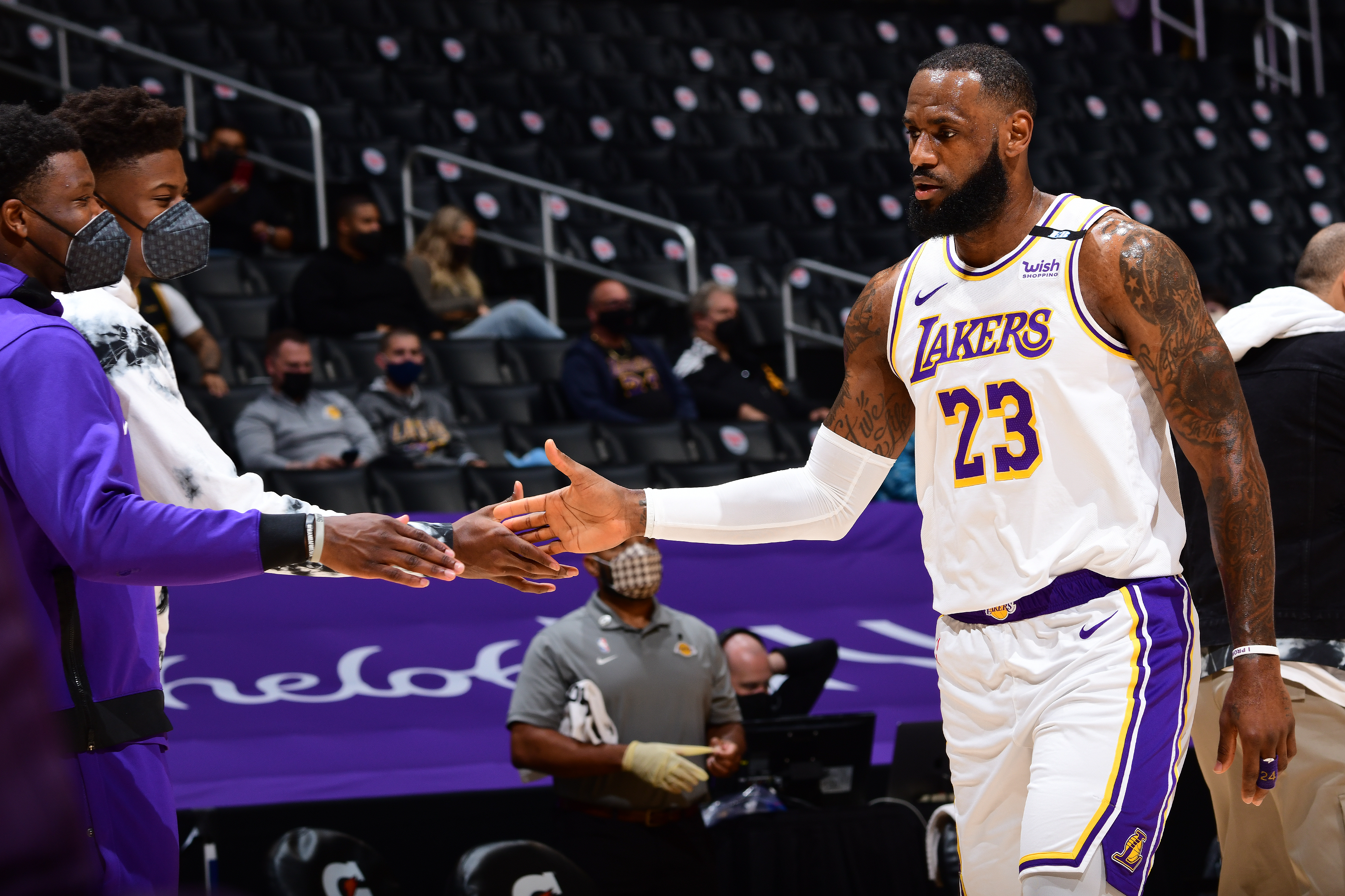 LeBron James of the Los Angeles Lakers high fives Kostas Antetokounmpo of the Los Angeles Lakers during the game against the Toronto Raptors on May 2, 2021 at STAPLES Center in Los Angeles, California.