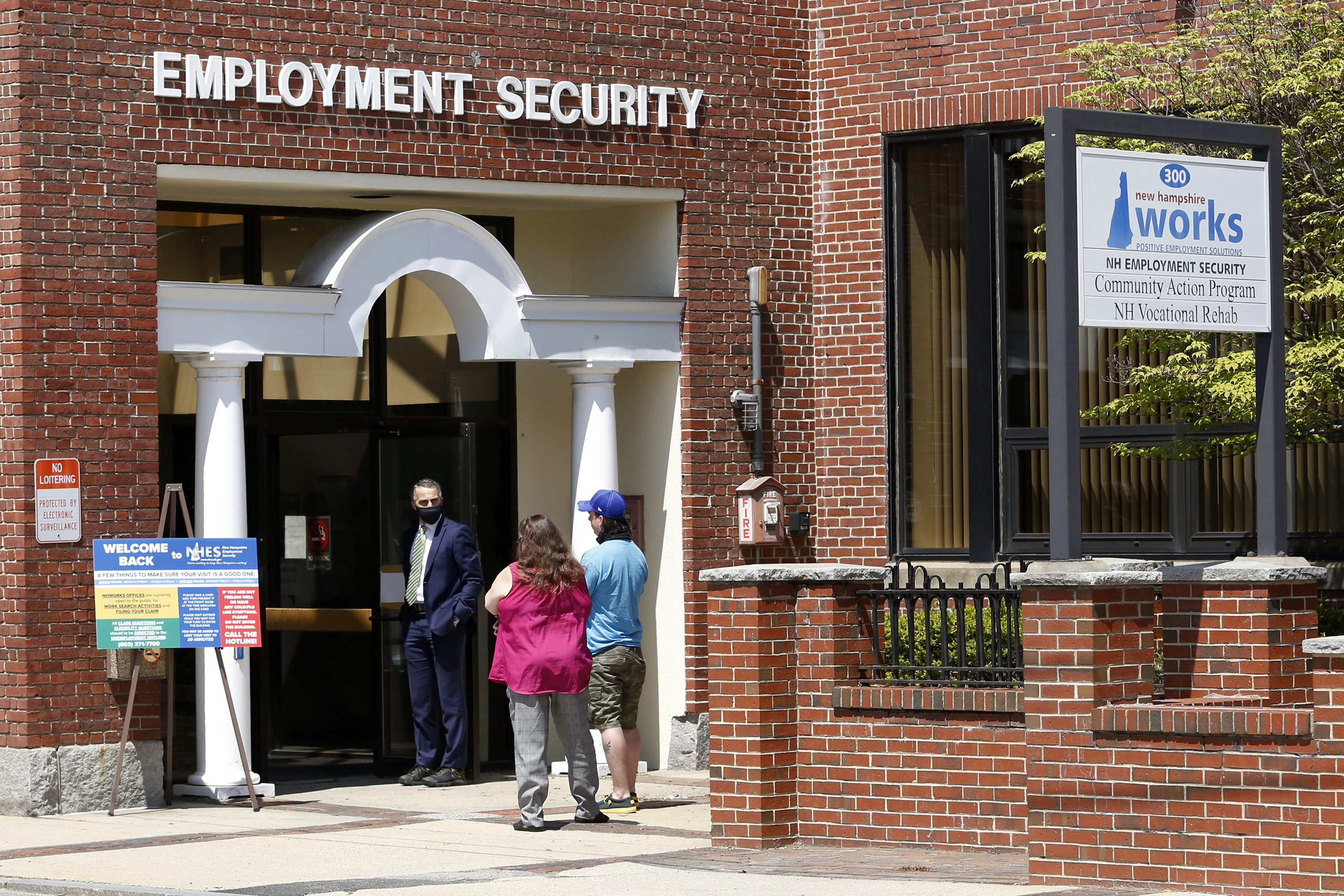 Job seekers line up outside the New Hampshire Works employment security job center, Monday, May 10, 2021, in Manchester, N.H.