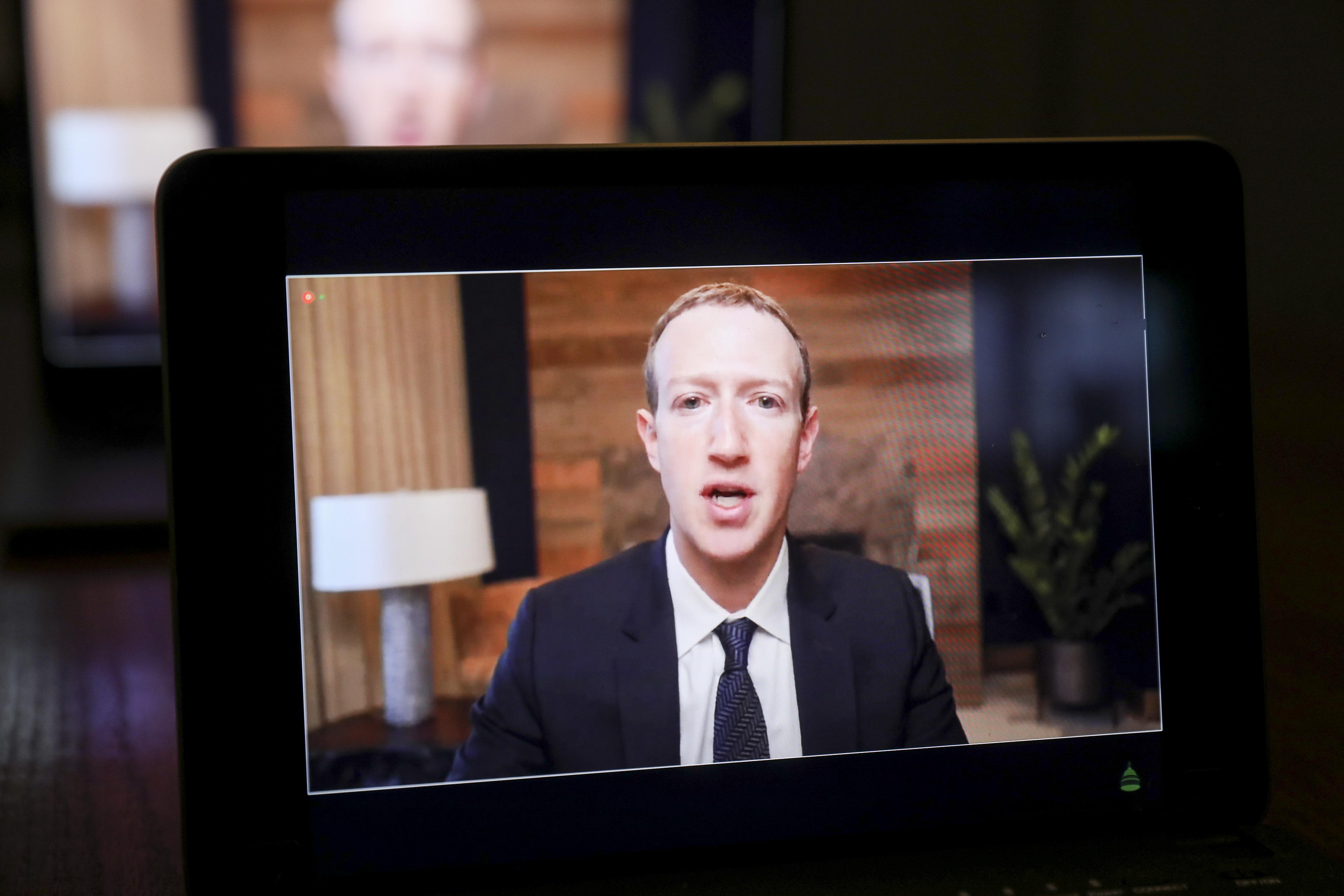 Mark Zuckerberg appearing on a laptop screen.