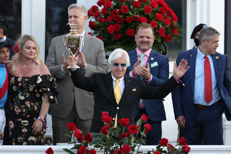 Trainer Bob Baffert of Medina Spirit, raises the trophy after winning the 147th running of the Kentucky Derby with Medina Spirit, his seventh career Kentucky Derby win, at Churchill Downs on May 01, 2021 in Louisville, Kentucky.