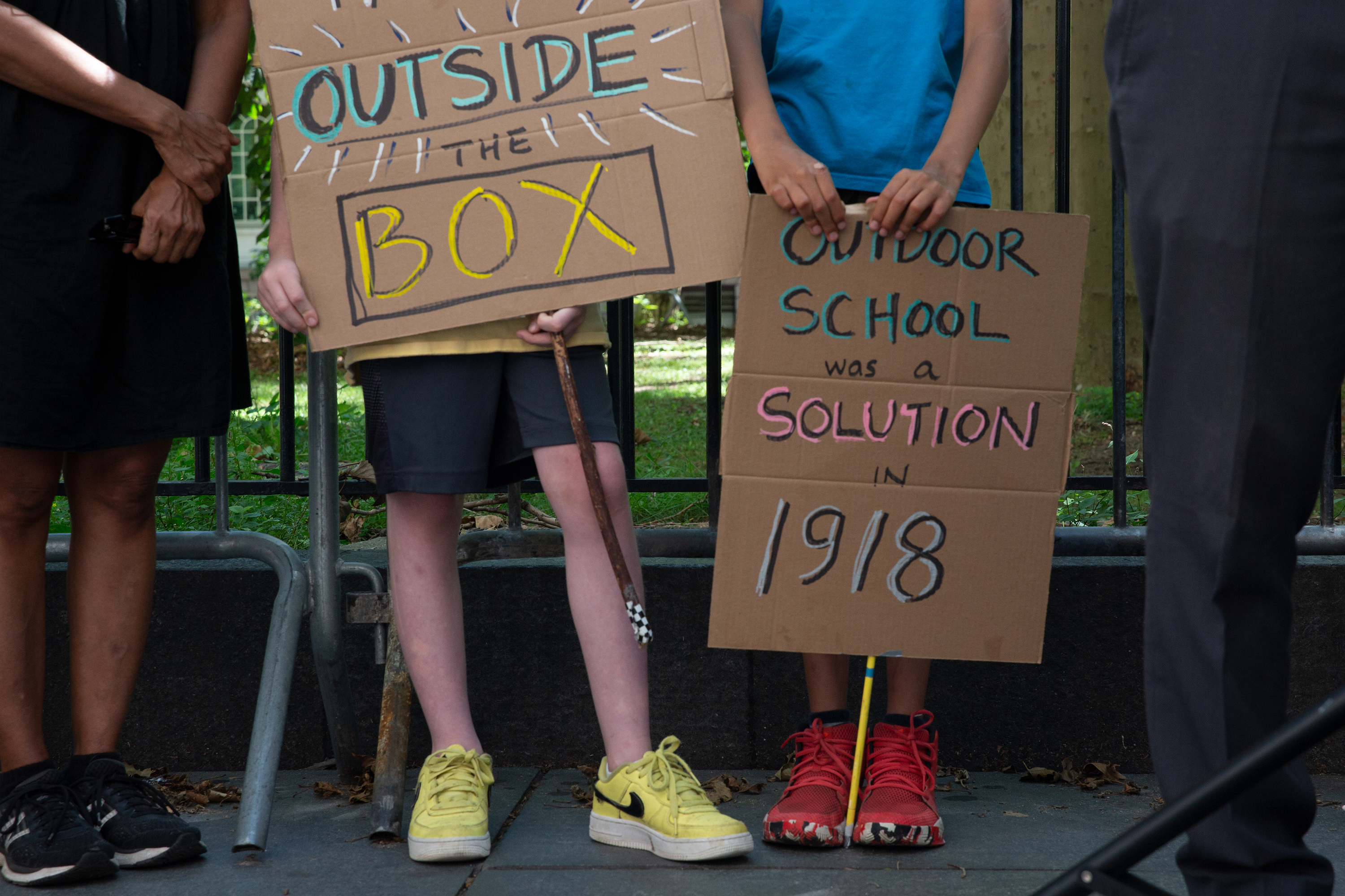 Students rally outside City Hall for holding outdoor classes during the fall semester, Aug. 20, 2020.