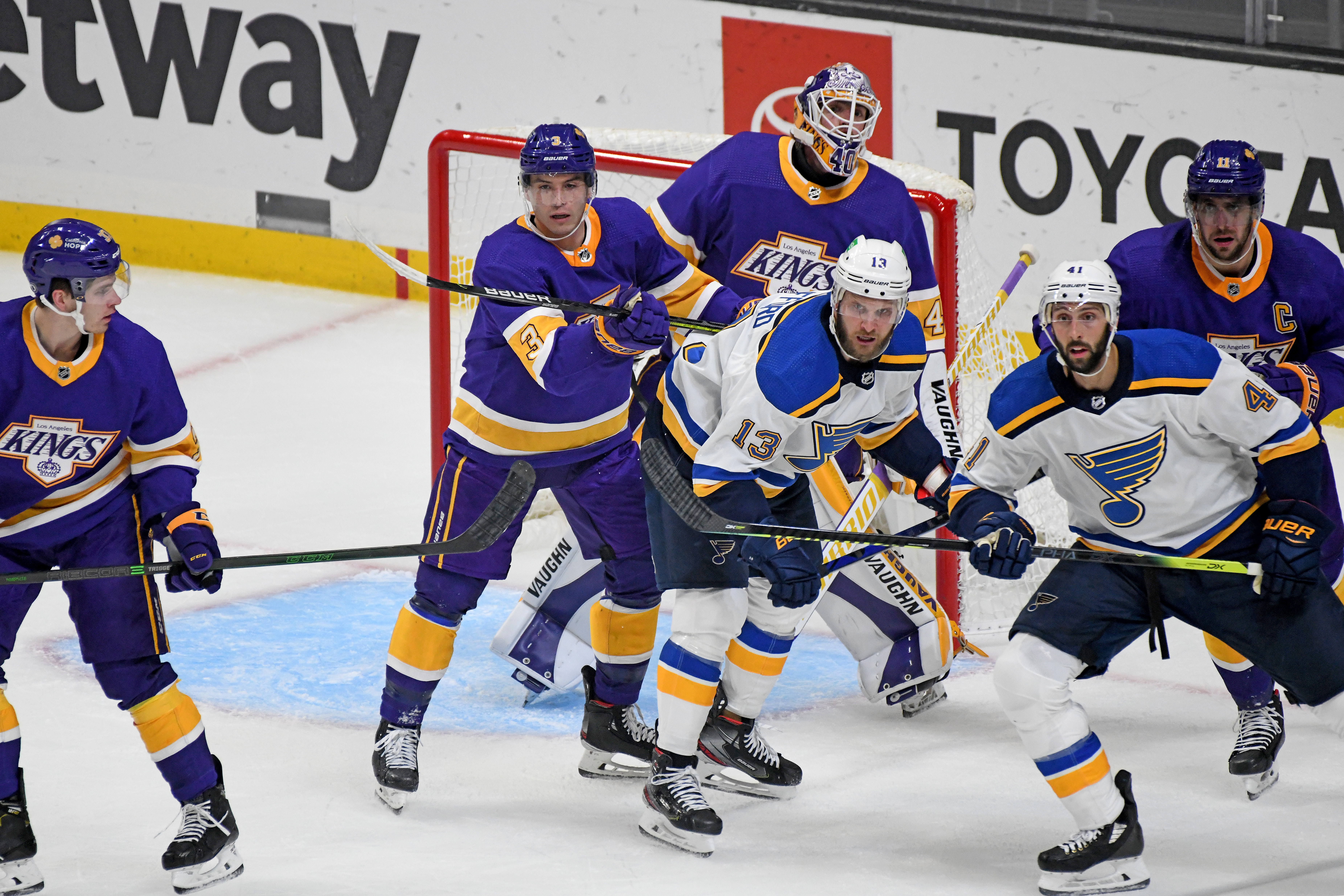 Los Angeles Kings Defenceman Matt Roy (3) battles with St. Louis Blues Left Wing Kyle Clifford (13) as Los Angeles Kings Goalie Cal Petersen (40) looks on during a National Hockey League game at the Staples Center in Los Angeles, CA.