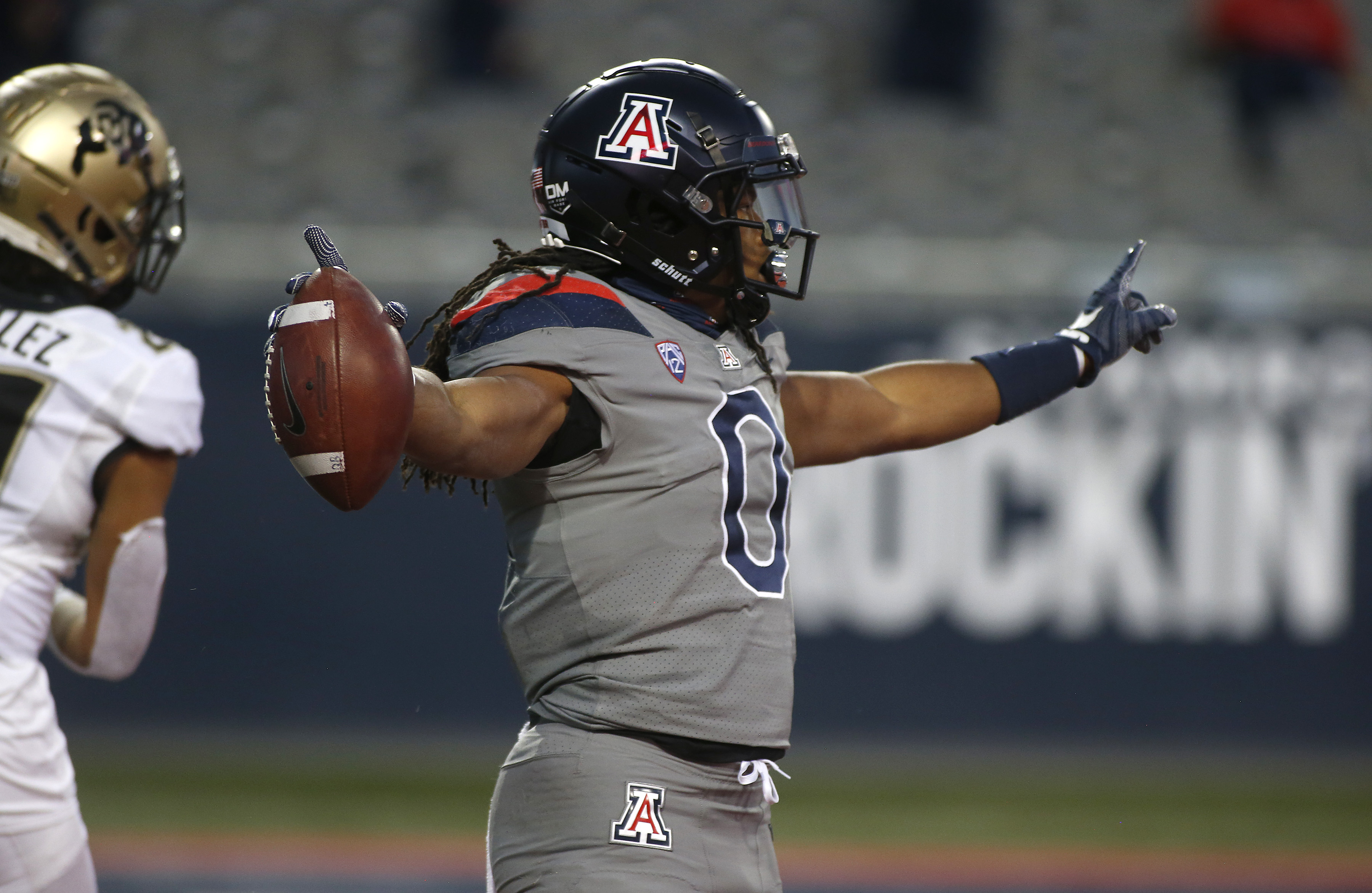 Running back Gary Brightwell #0 of the Arizona Wildcats celebrates after scoring a touchdown against the Colorado Buffaloes during the first half of the PAC-12 football game at Arizona Stadium on December 05, 2020 in Tucson, Arizona.