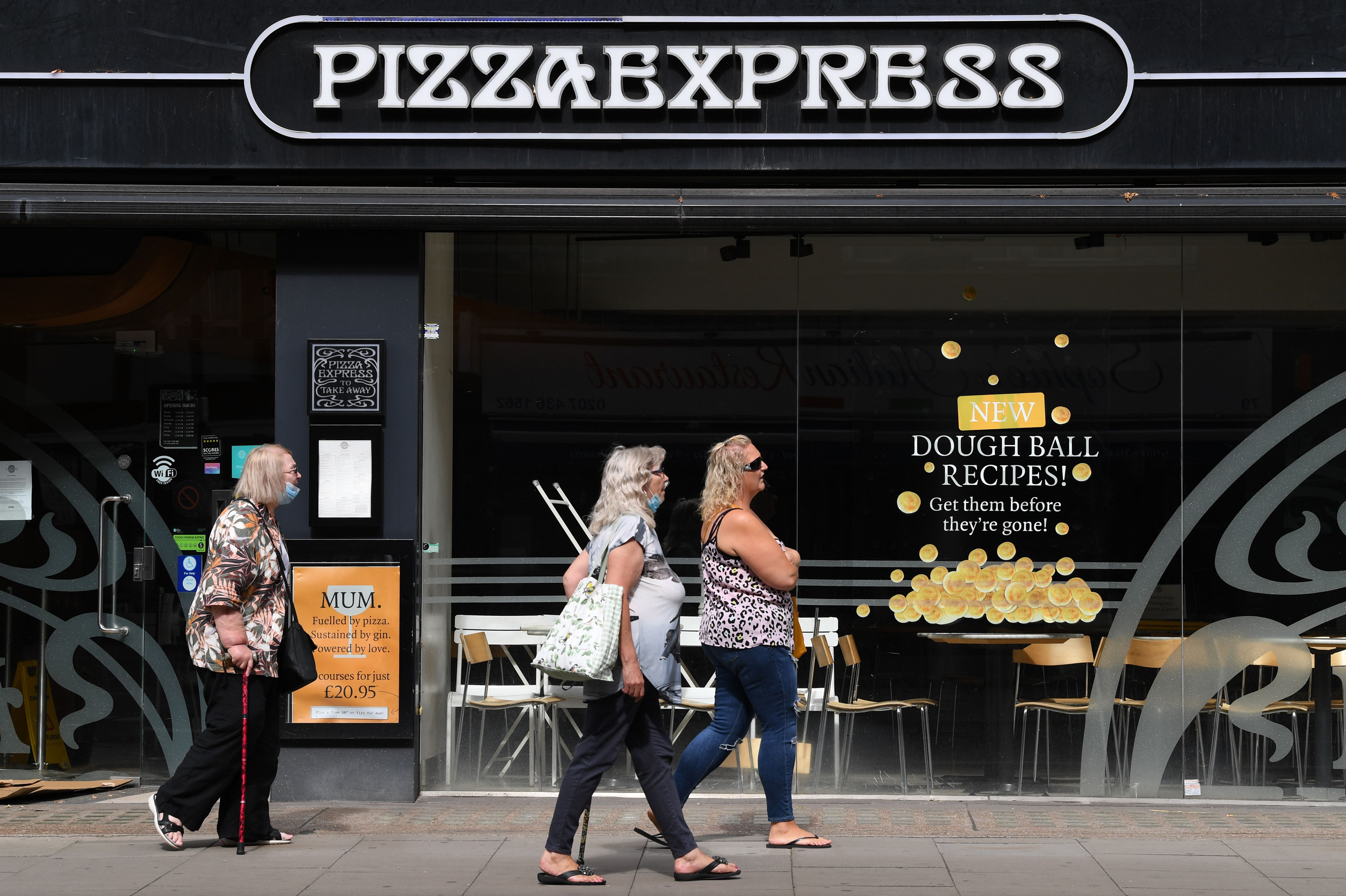 Diners walk past Pizza Express in central London in summer 2020